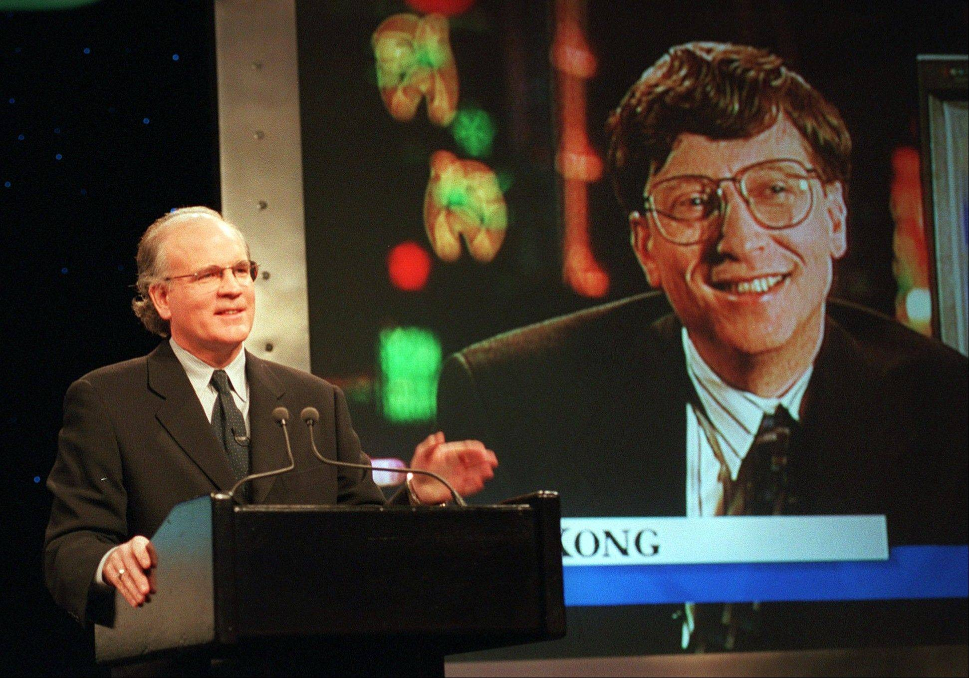 In this Dec. 14, 1995, file photo, Robert Wright, president and chief executive officer of NBC, speaks in New York with Microsoft Chairman Bill Gates, displayed on screen, speaks from Hong Kong, during a news conference announcing that NBC and Microsoft would form a joint venture to start a cable news channel and related online service called MSNBC.
