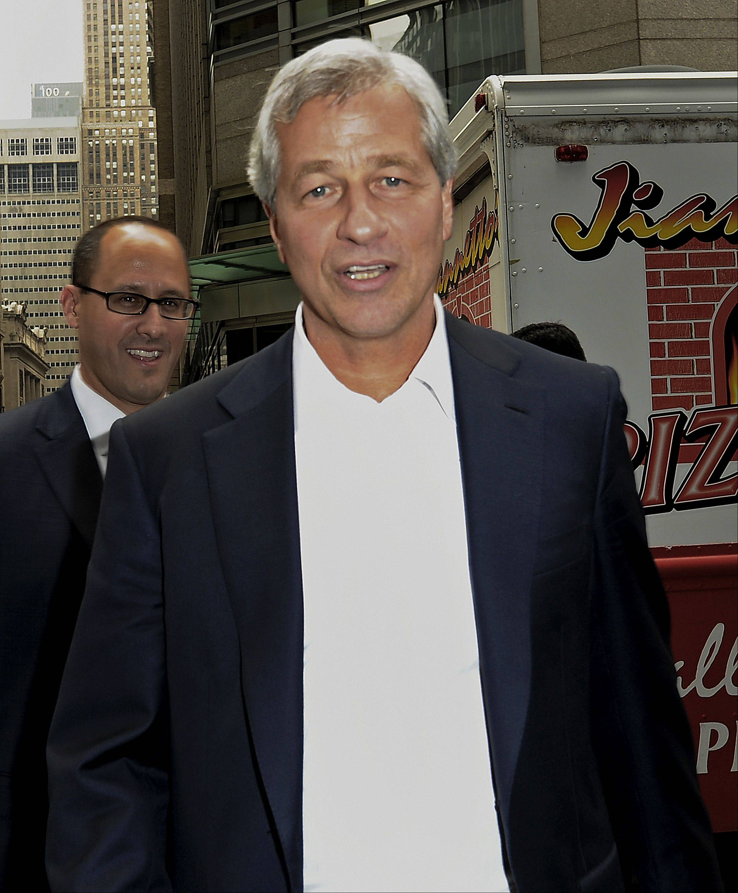 Jamie Dimon, chief executive officer of JPMorgan Chase & Co., walks outside company headquarters in New York, U.S., on Friday.