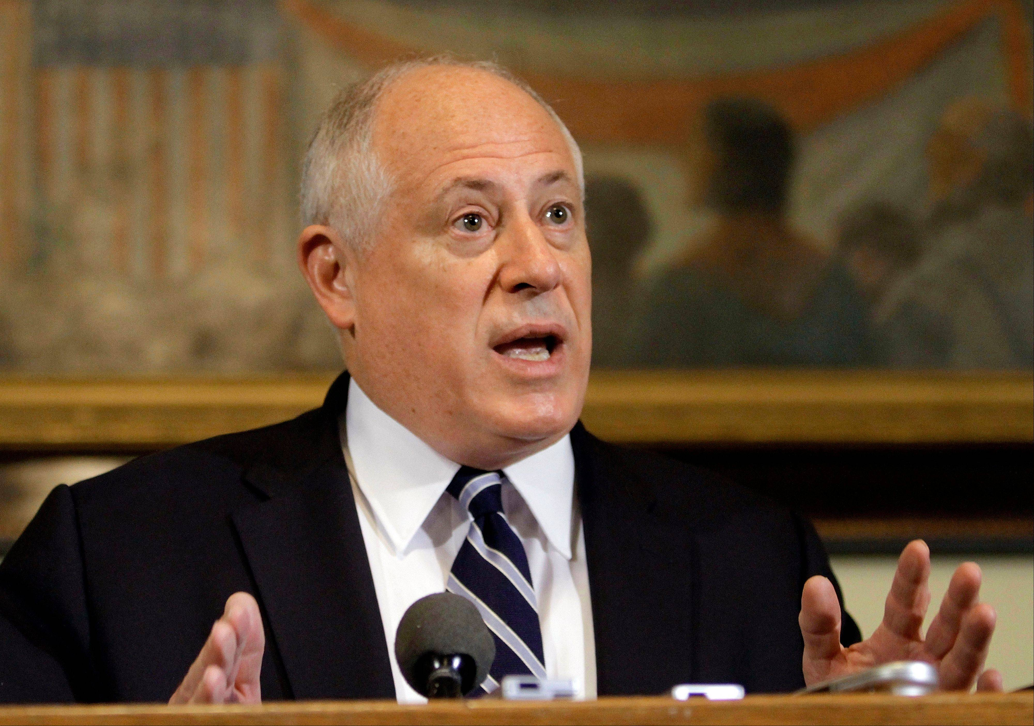 Gov. Pat Quinn speaks recently with reporters in his office at the Illinois State Capitol in Springfield.