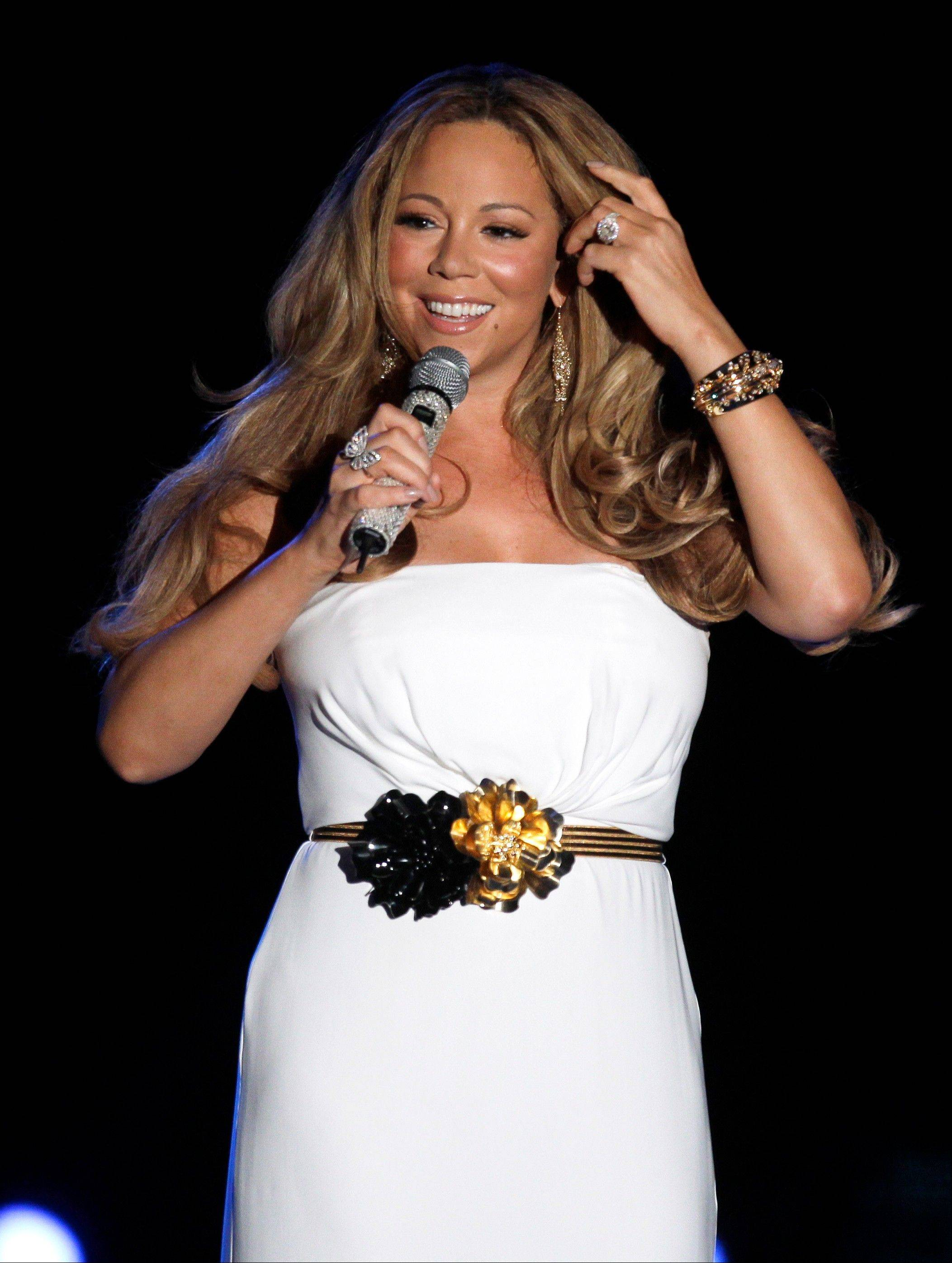 "Singer Mariah Carey is being pursued to join the judging panel of the Fox talent competition ""American Idol."""