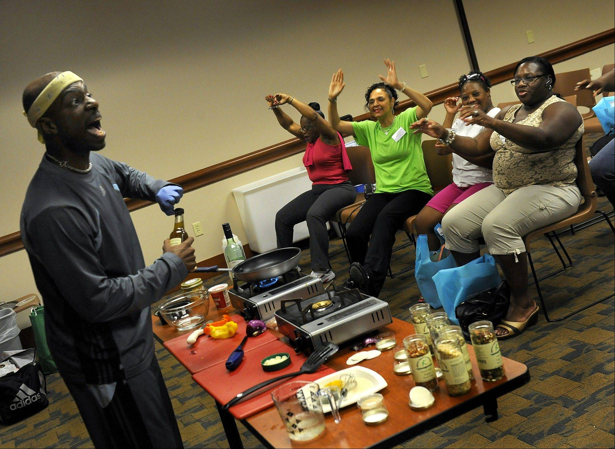 "Keith Johnson tells students to ""get those arms up!"" as he teaches an exercise class at First Baptist Church of Glenarden. The class is one of the ways African American congregations are reinforcing the importance of diet and exercise."