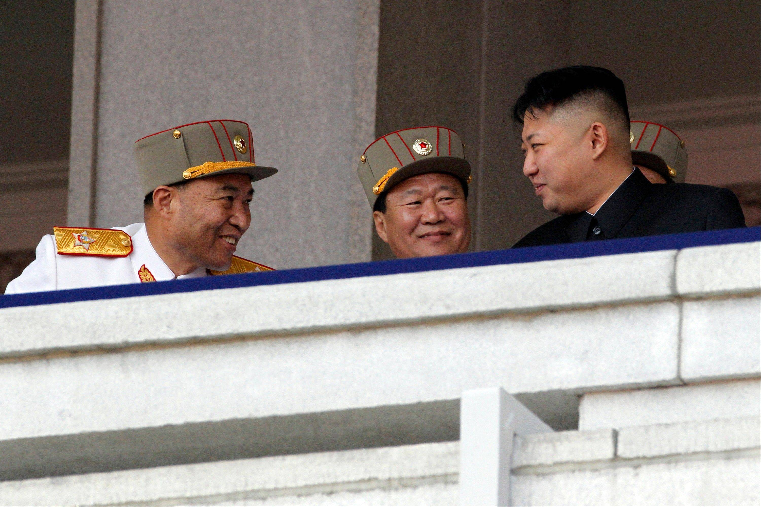 In this photo taken Sunday, April 15, North Korean leader Kim Jong Un, right, looks over at North Korean People's Army senior officers, Vice Marshal and Vice Chairman of the Central Military Commission Choe Ryong Hae, center, and Vice Marshal and the military's General Staff Chief Ri Yong Ho, left, during a mass military parade in Kim Il Sung Square to celebrate the centenary of the birth of his grandfather, national founder Kim Il Sung in Pyongyang, North Korea. North Korea said Monday, July 16, 2012 it has relieved Ri Yong Ho from all posts because of illness.