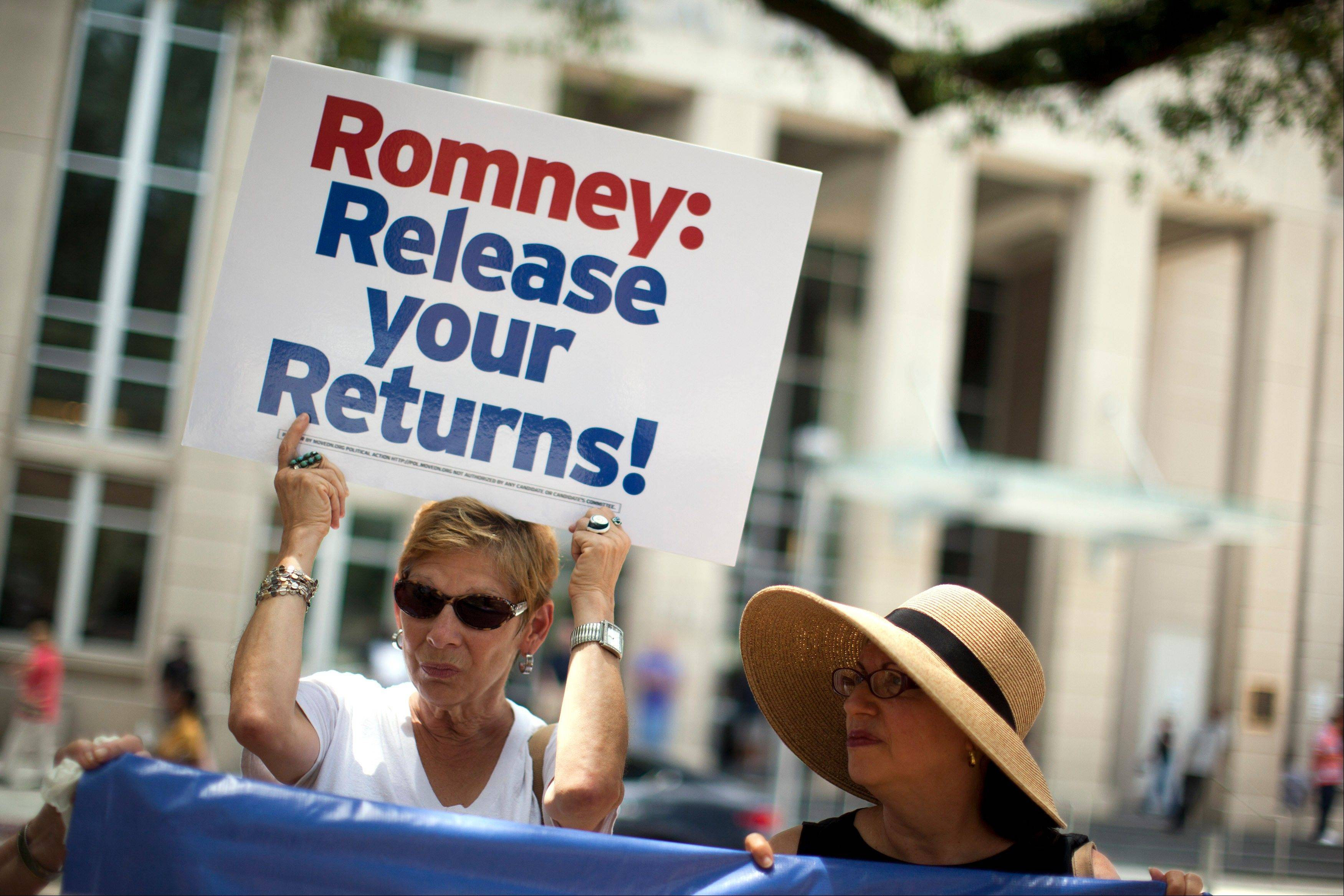 Sharon Simon, of Baton Rouge, La., left, and Ellen Bander, of Baton Rogue, La., protest outside a fundraiser for Republican presidential candidate, former Massachusetts Gov. Mitt Romney on Monday in Baton Rouge, La.