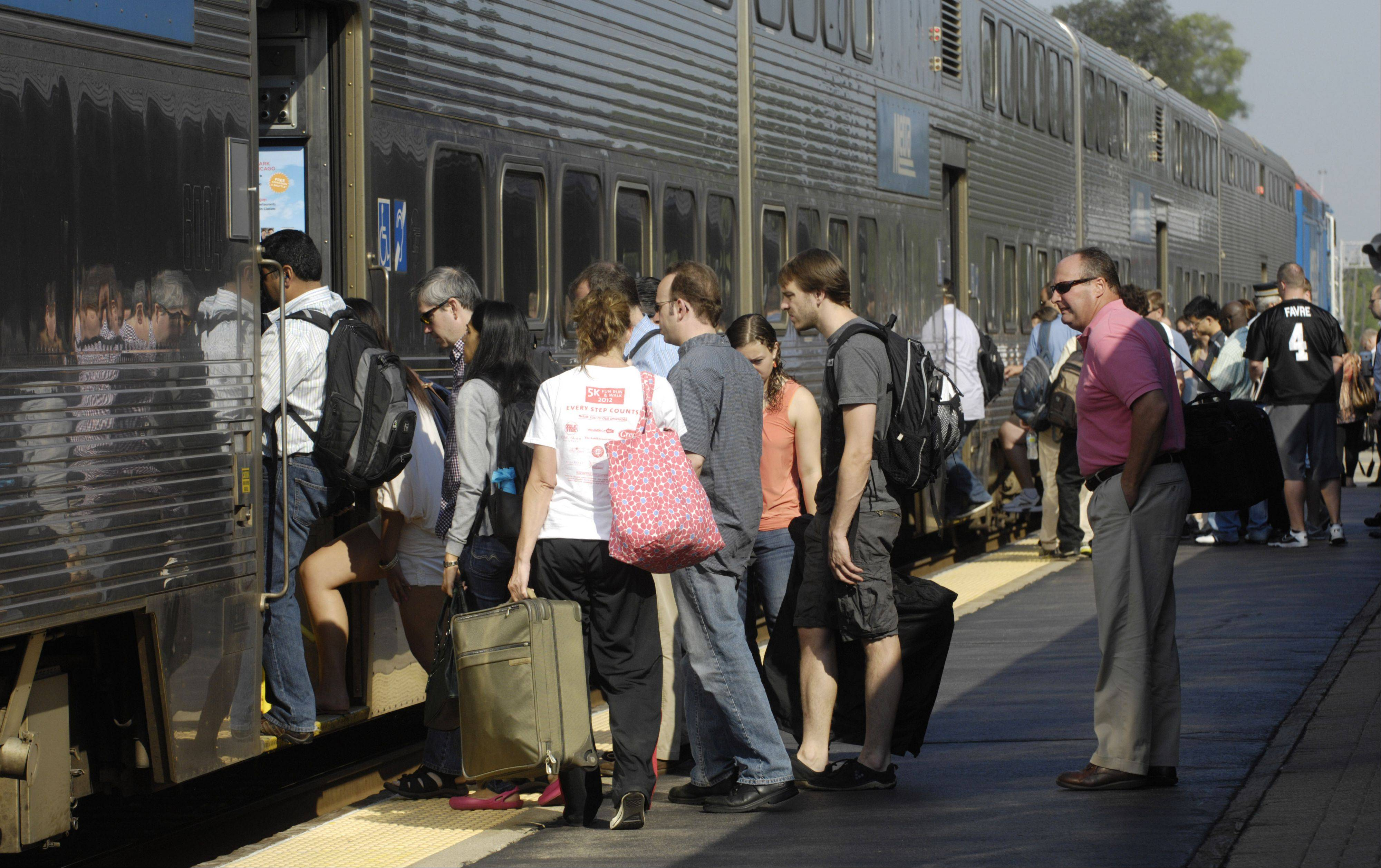 Want more train cars? Metra wants commuters like these at the Arlington Heights station on the UP Northwest Line to contribute to its strategic plan.