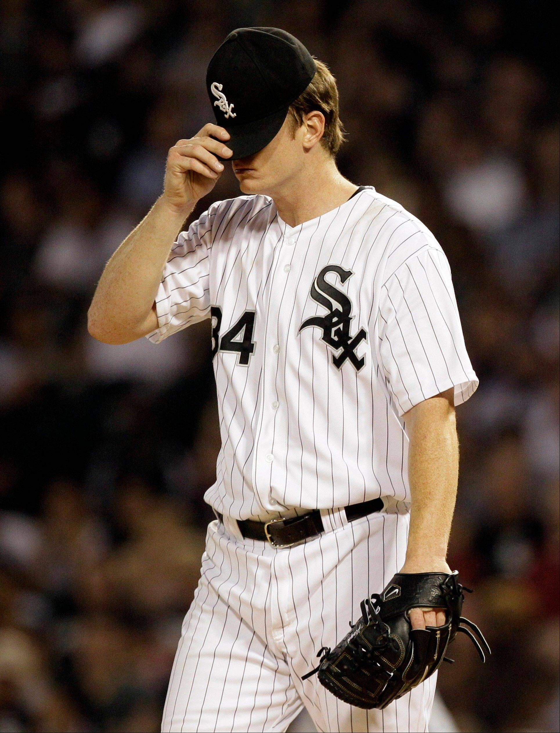 White Sox starter Gavin Floyd is not sure how things are looking because he has been sidelined with arm pain.
