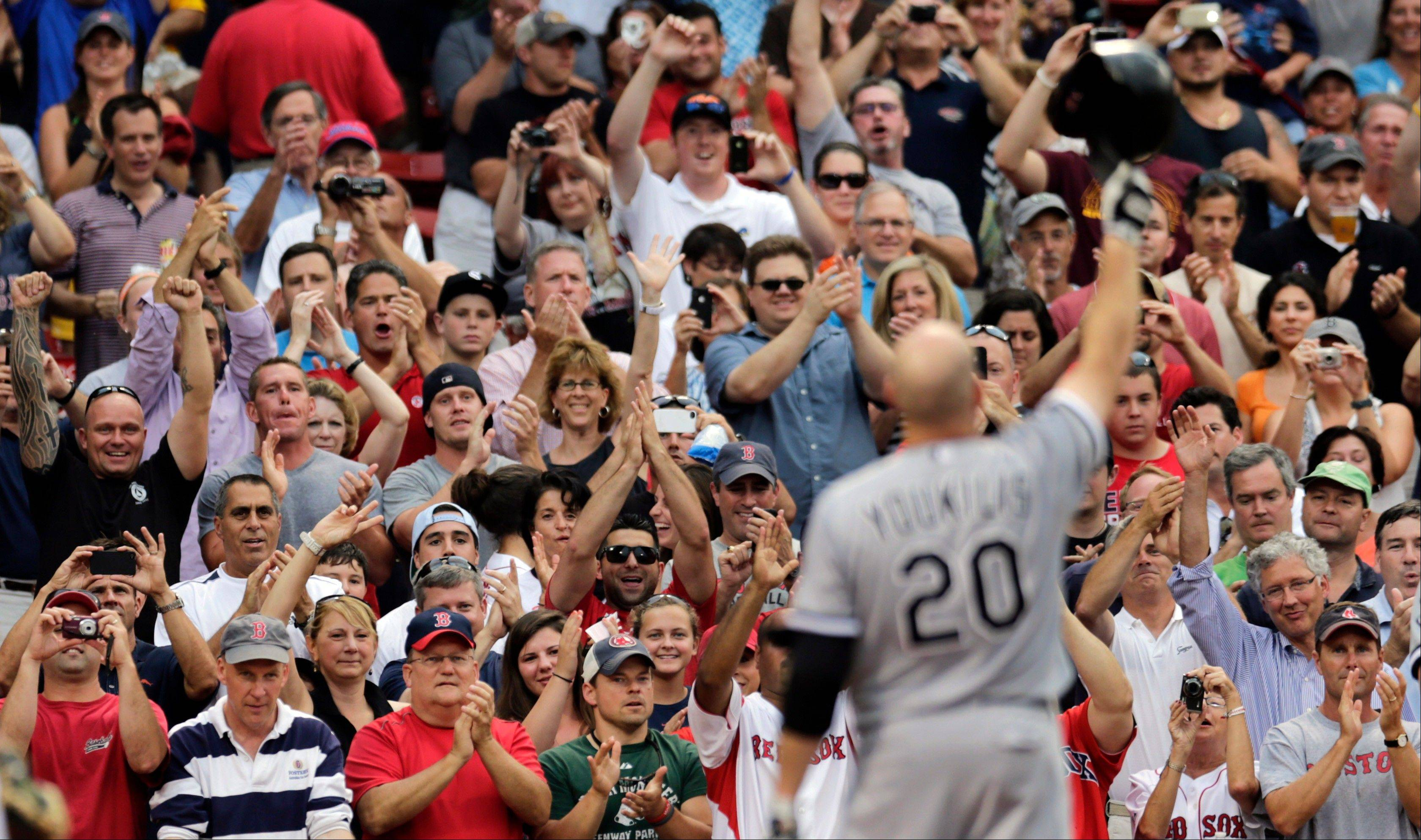White Sox third baseman Kevin Youkilis tips his batting helmet to fans Monday as he receives a standing ovation during the first inning against the Boston Red Sox at Fenway Park. Youkilis was traded from Boston to Chicago earlier this summer.