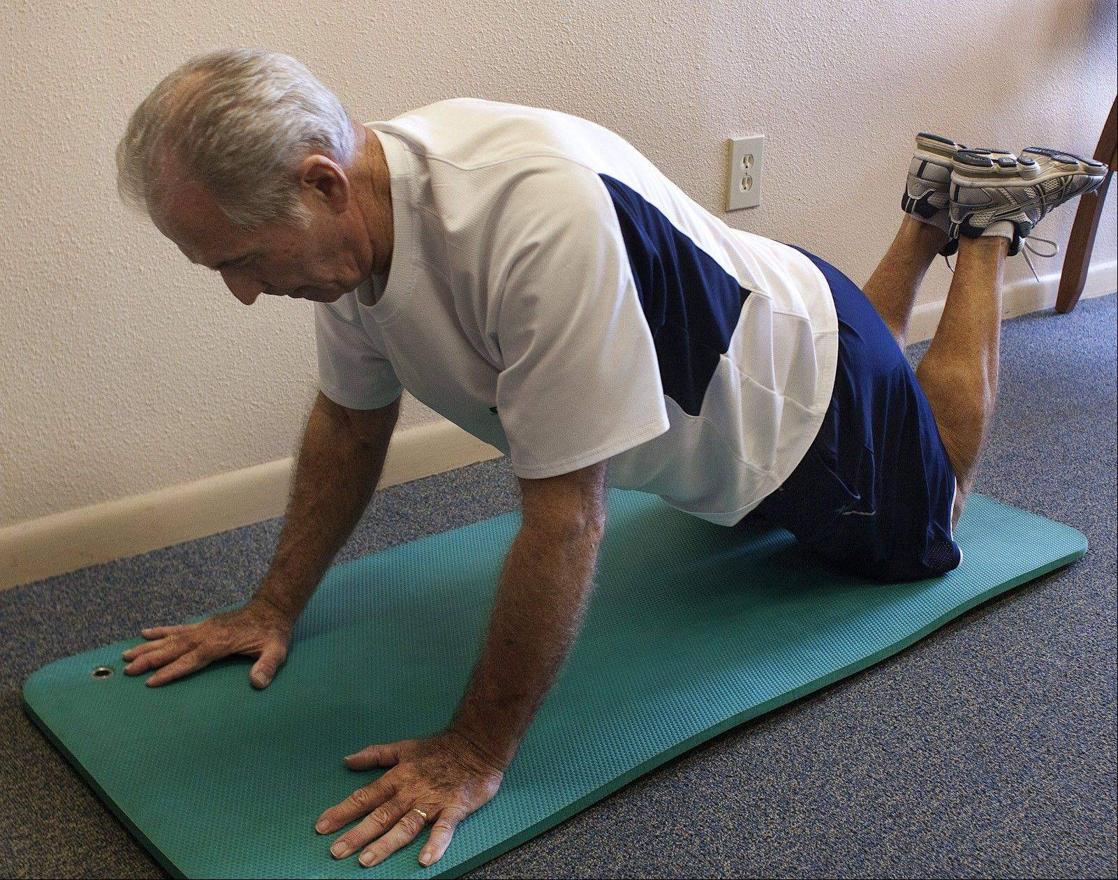 Bob Cole demonstrates position 1 of a modified push-up.