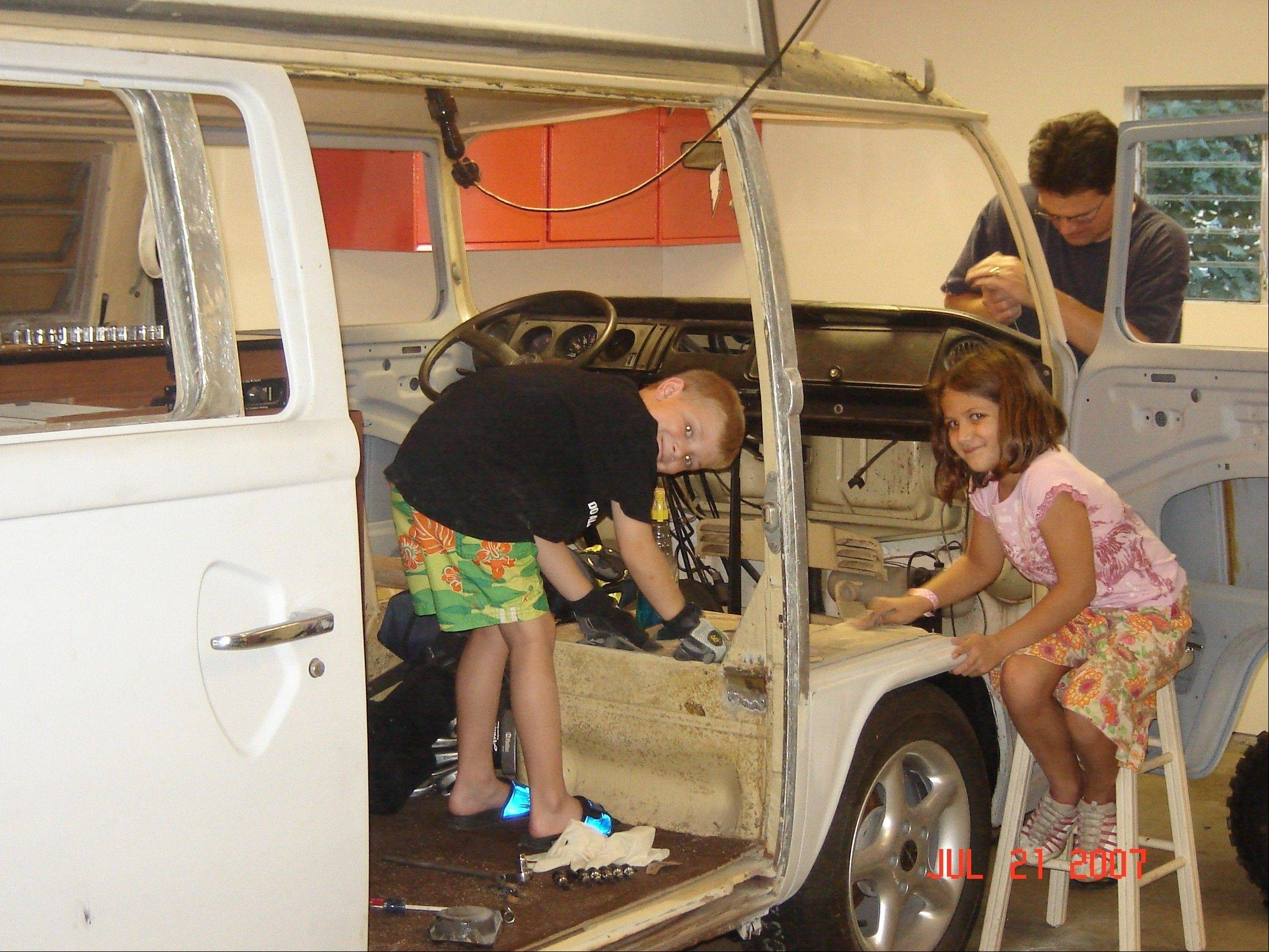 Jack Connelly Jr. and his sister Anna help out their dad during the restoration process.