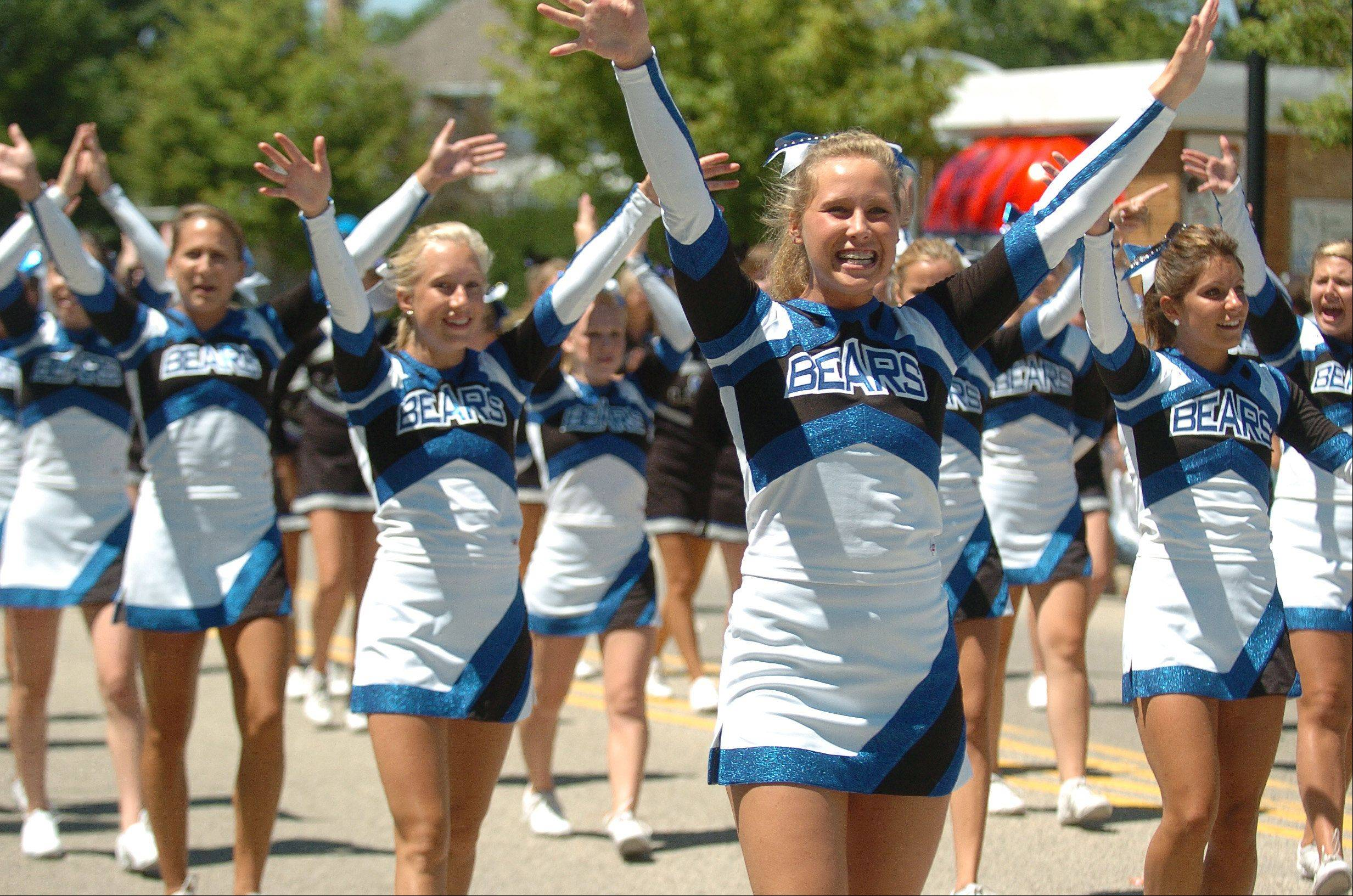 Cheerleaders perform during the Alpine Days Festival Parade.