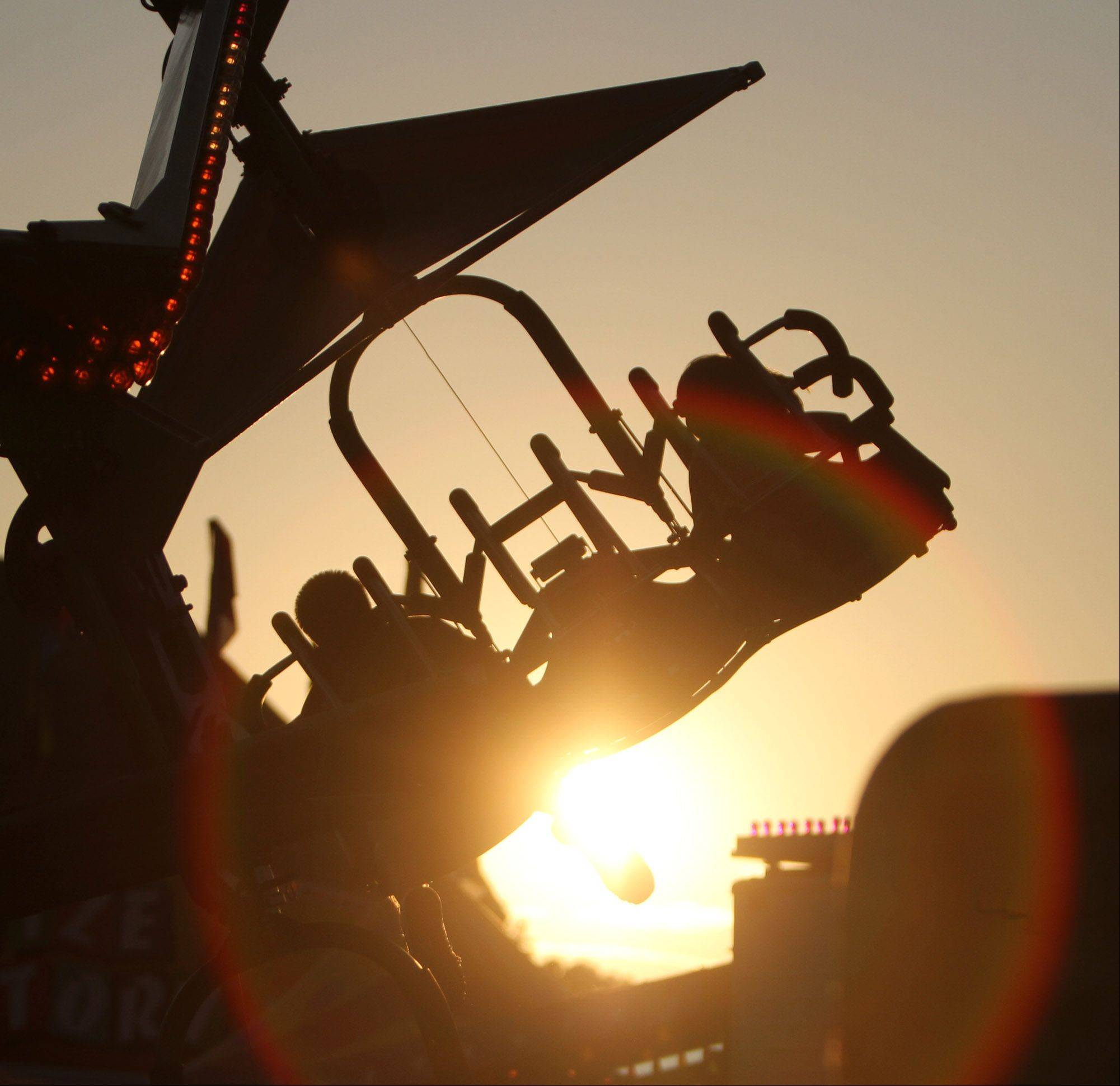 The sun sets on riders on the Cliff Hanger at the Alpine Festival at Lions Park in Lake Zurich.