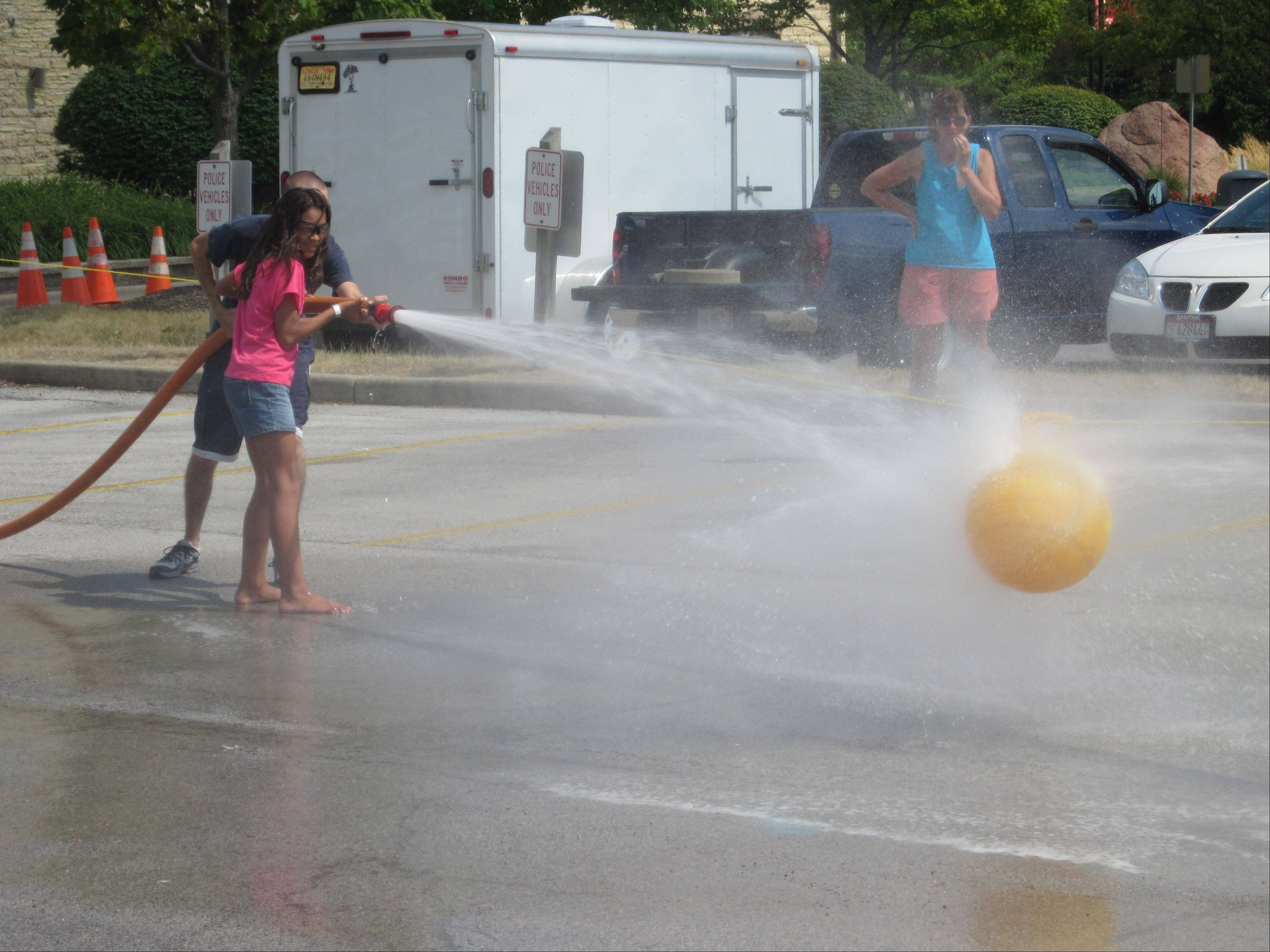 The fire hose challenge helped people beat the heat Sunday at the Windmill City Festival at the Riverwalk in downtown Batavia. The event also included an ice cream eating contest.