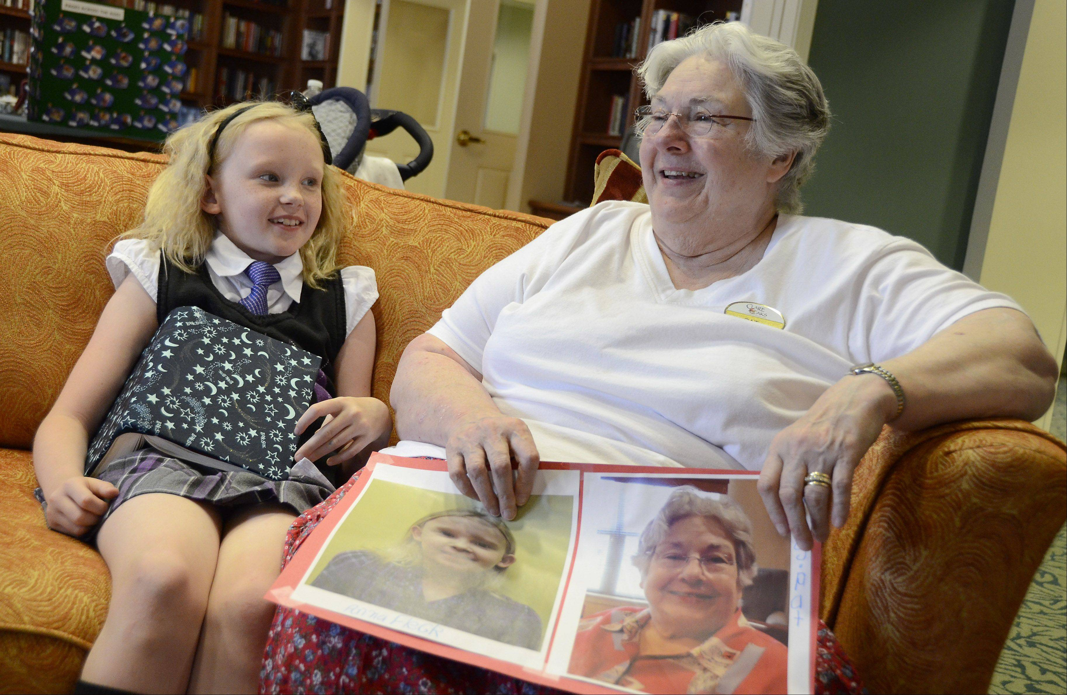 Anna Fleck, 8, and Pat Ozcomert chat at Clare Oaks Retirement Community. They met for the first time after corresponding to each other for two months as part of Pages Across Ages.