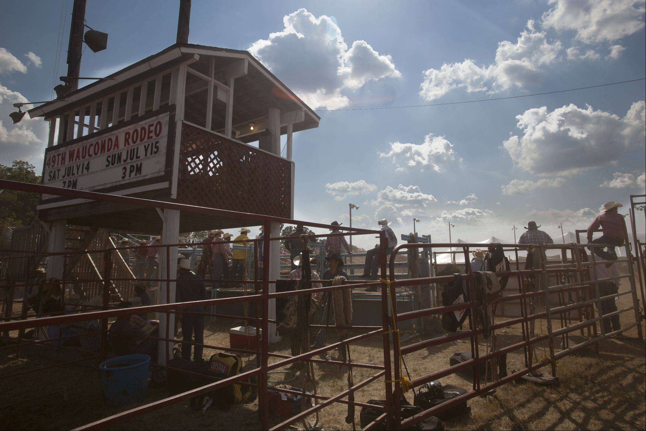 Cowboys sit around and wait their turn Sunday during the 49th IPRA Championship Rodeo in Wauconda.