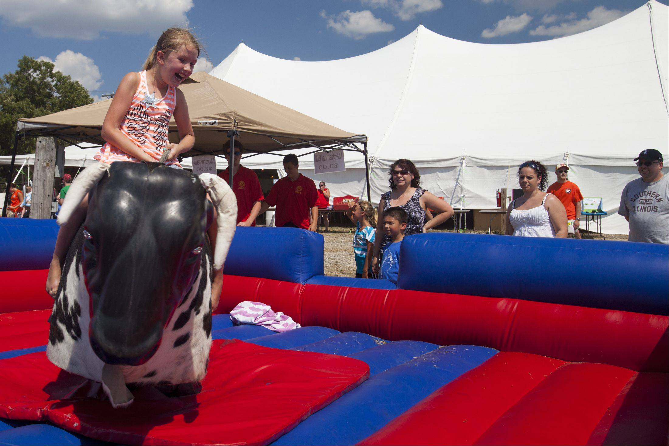 Ariana Hatfield, 8, of Wauconda rides a mechanical bull Sunday before the start of the 49th IPRA Championship Rodeo at Golden Oaks Rodeo Grounds in Wauconda.