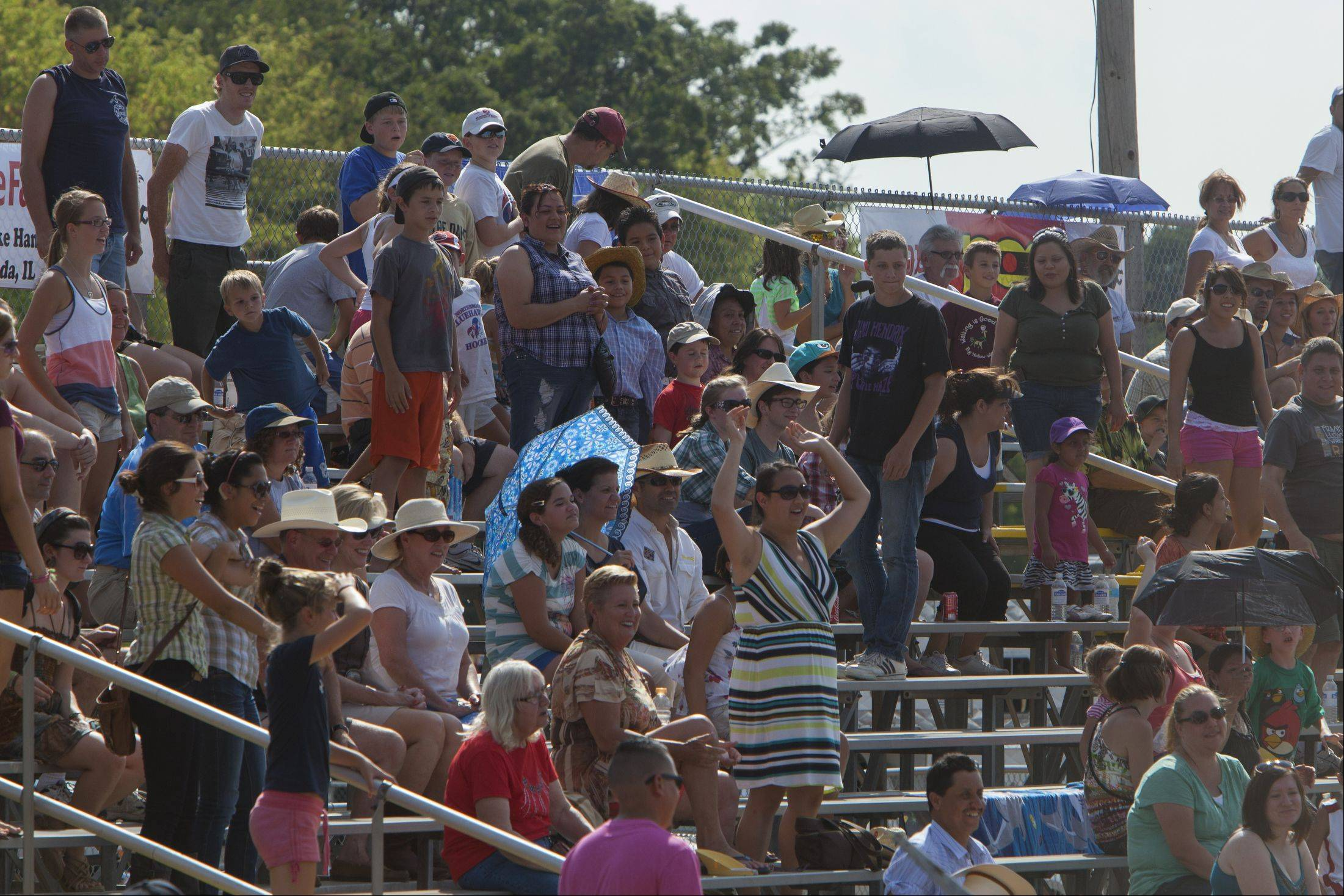 Despite temperatures in the id 90s, crowds enjoy the 49th IPRA Championship Rodeo at the Golden Oaks Rodeo Grounds in Wauconda, hosted by the Wauconda Chamber of Commerce.