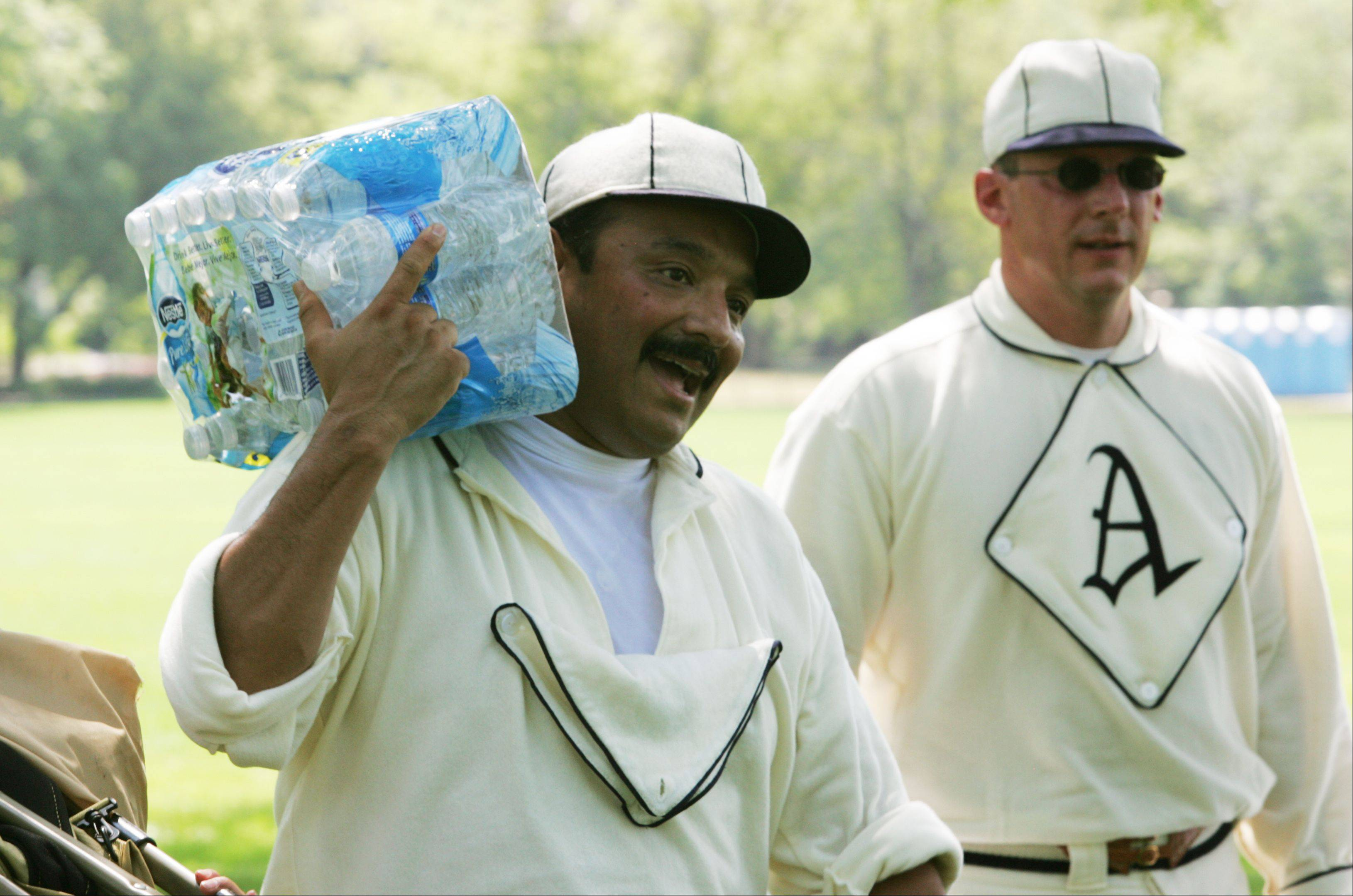 Reynaldo Rivera keeps cool between games during the Northern Illinois Vintage Baseball Tournament held at Cantigny Park in Wheaton. Rivera and teammate Paul Nelson, right, play for the Aurora Town Club Vintage Baseball team.