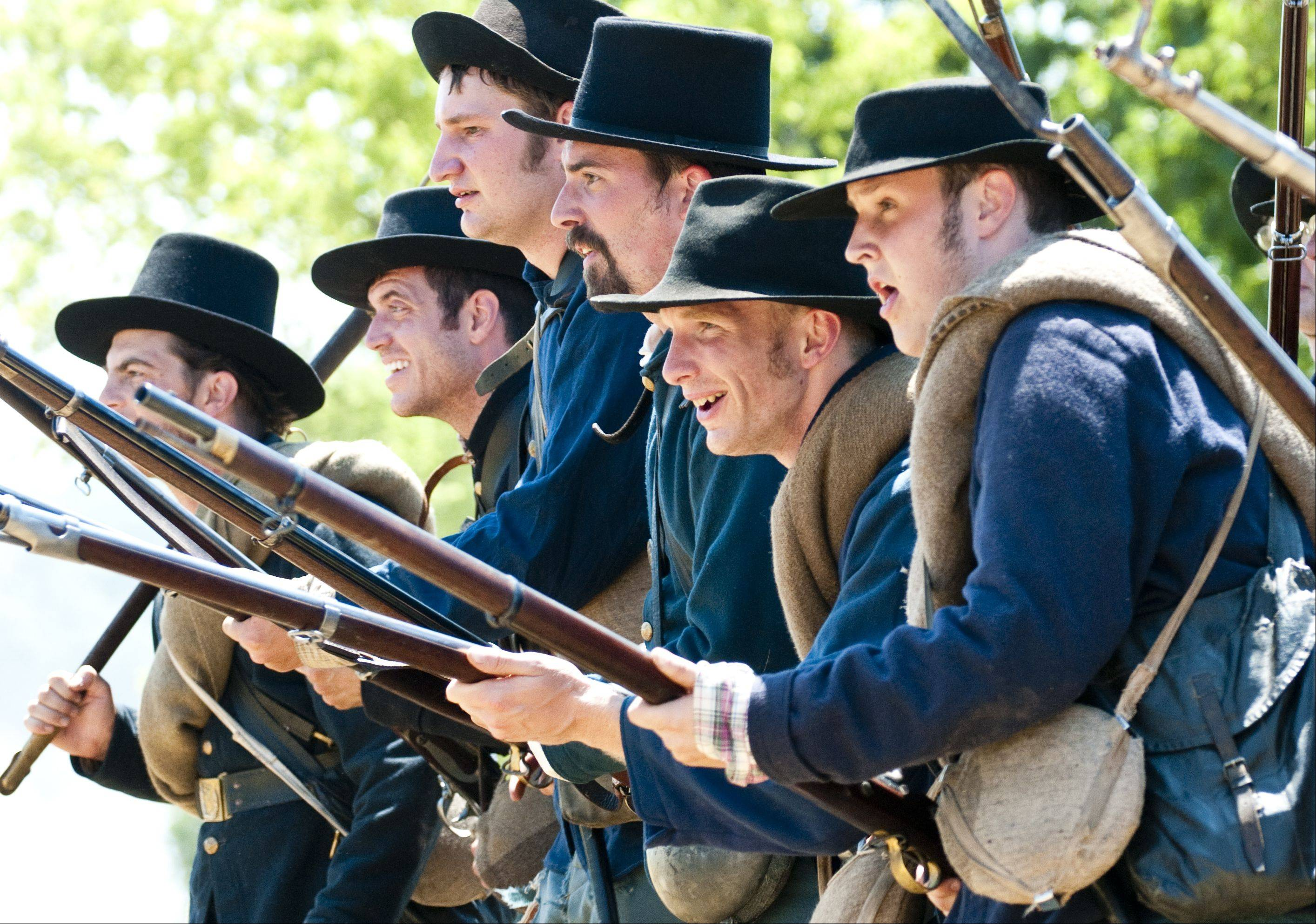 Union soldiers advance on a Confederate dispatch during Civil War Days Sunday in the Lakewood Forest Preserve near Wauconda. The hourlong battle featured booming canon fire and extensive military maneuvering across the fields of the preserve.