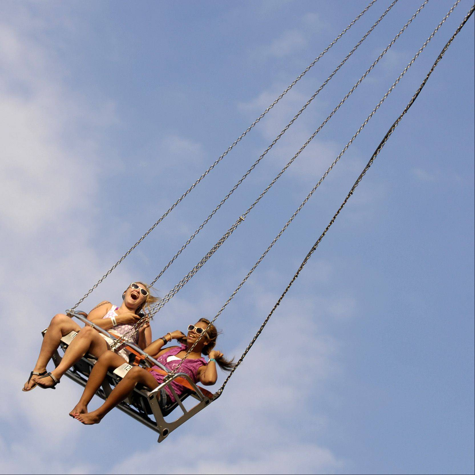 "Safia Baldwin and Jamie Russell both 14 of Glendale Heights take a ride on the ""Vertigo"" during the second day of Glendale Heights Fest, Thursday."