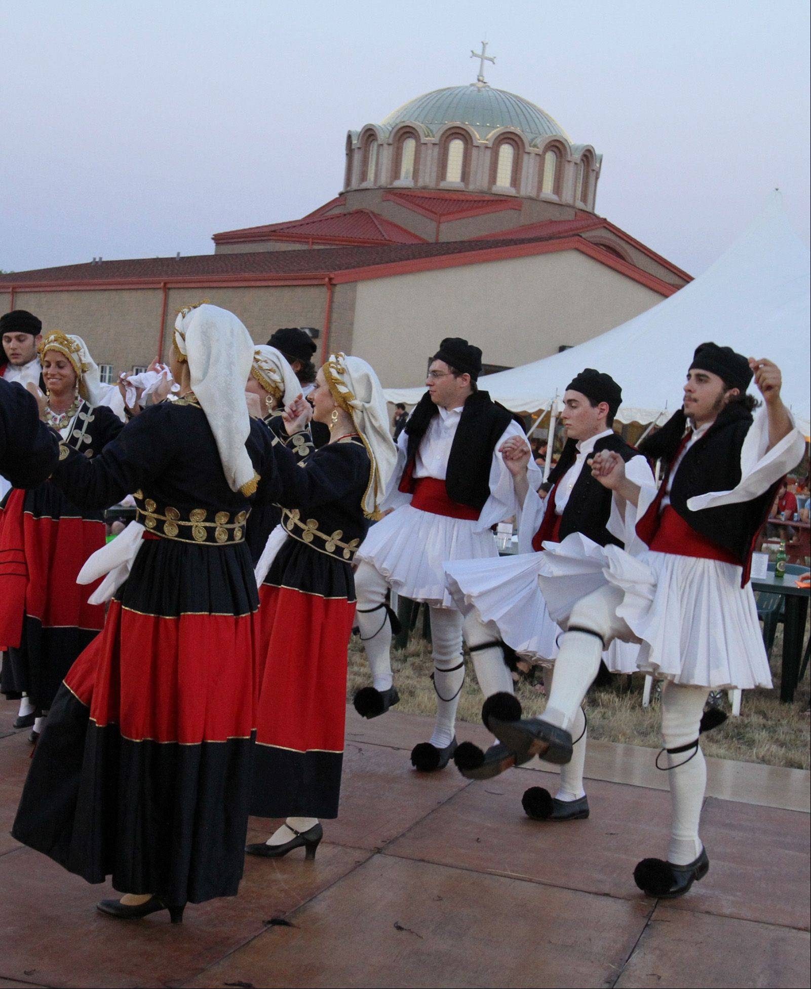 Dionysos DanceTroupe with St. Demetrios Greek Orthodox Church in Elmhurst dances at the Greek fest at St. Demetrios Greek Orthodox Church in Libertyville on Friday. The dance troupe preforms at the festival again on Saturday and Sunday.