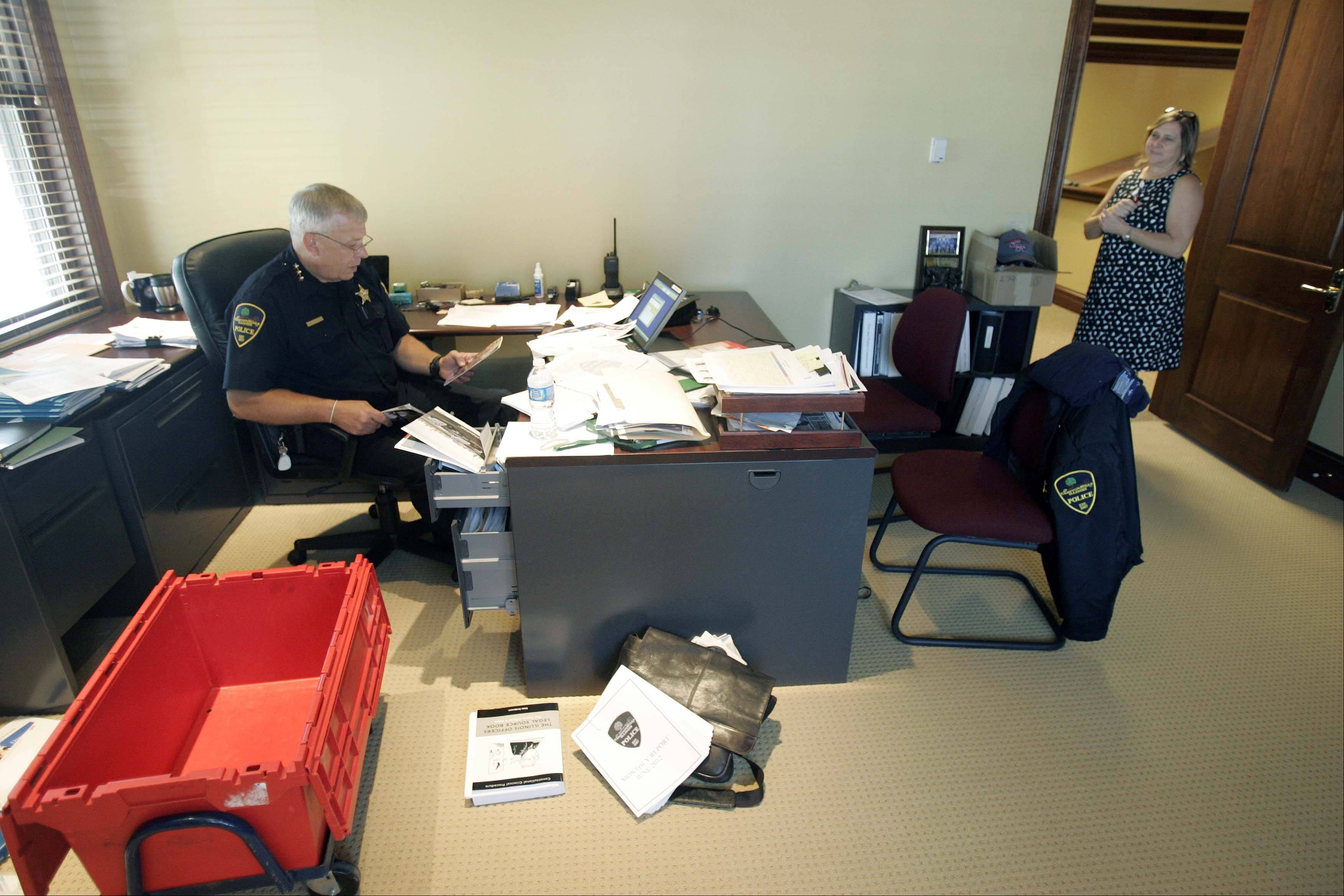 Campton Hills Village President Patsy Smith checks on Police Daniel Hoffman as he settles into his office Tuesday at the new Campton Hills Village Hall.