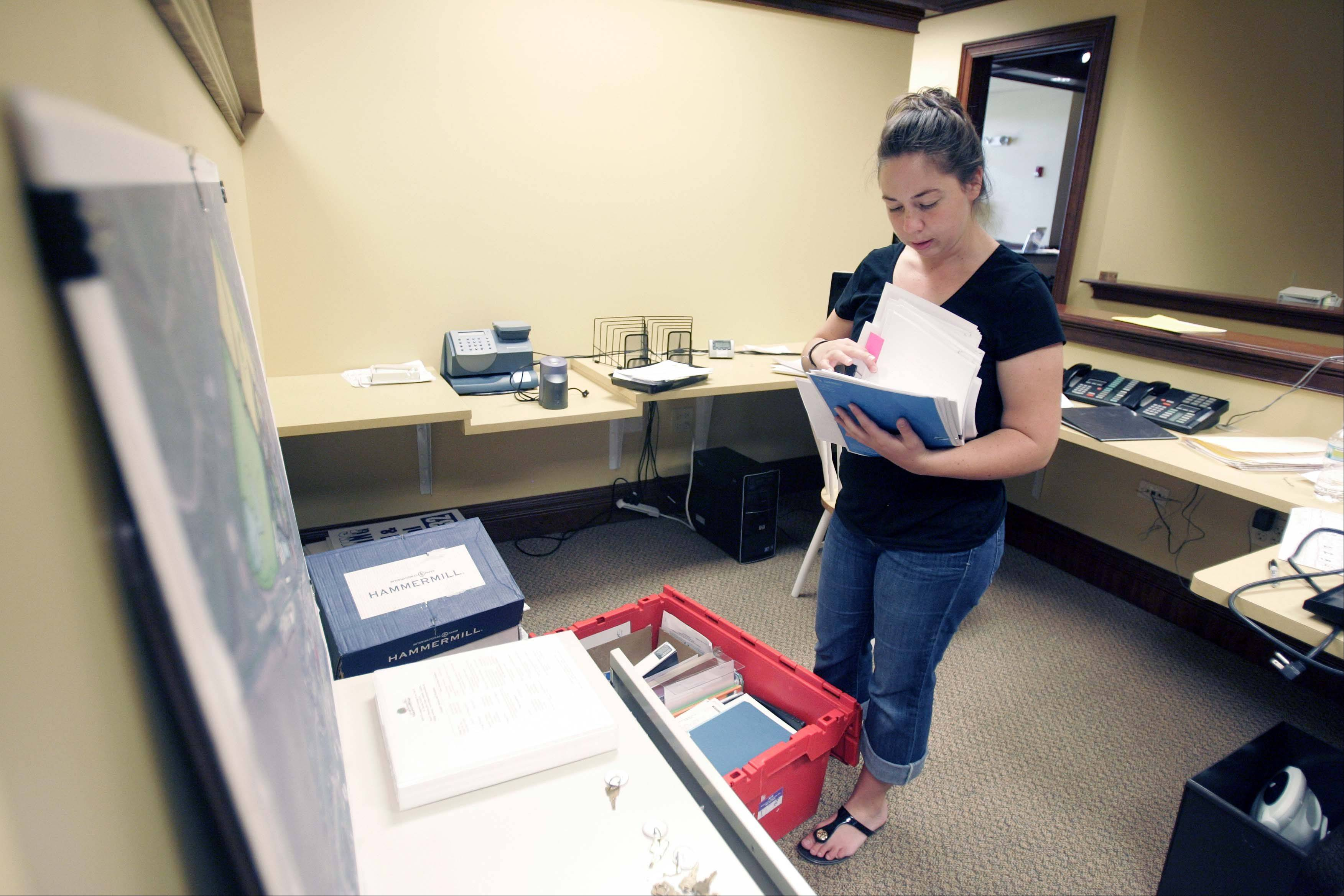 Campton Hills Land Planner Nicki Brickman sorts through files as she moves into her new space Tuesday at the Campton Hills Village Hall.