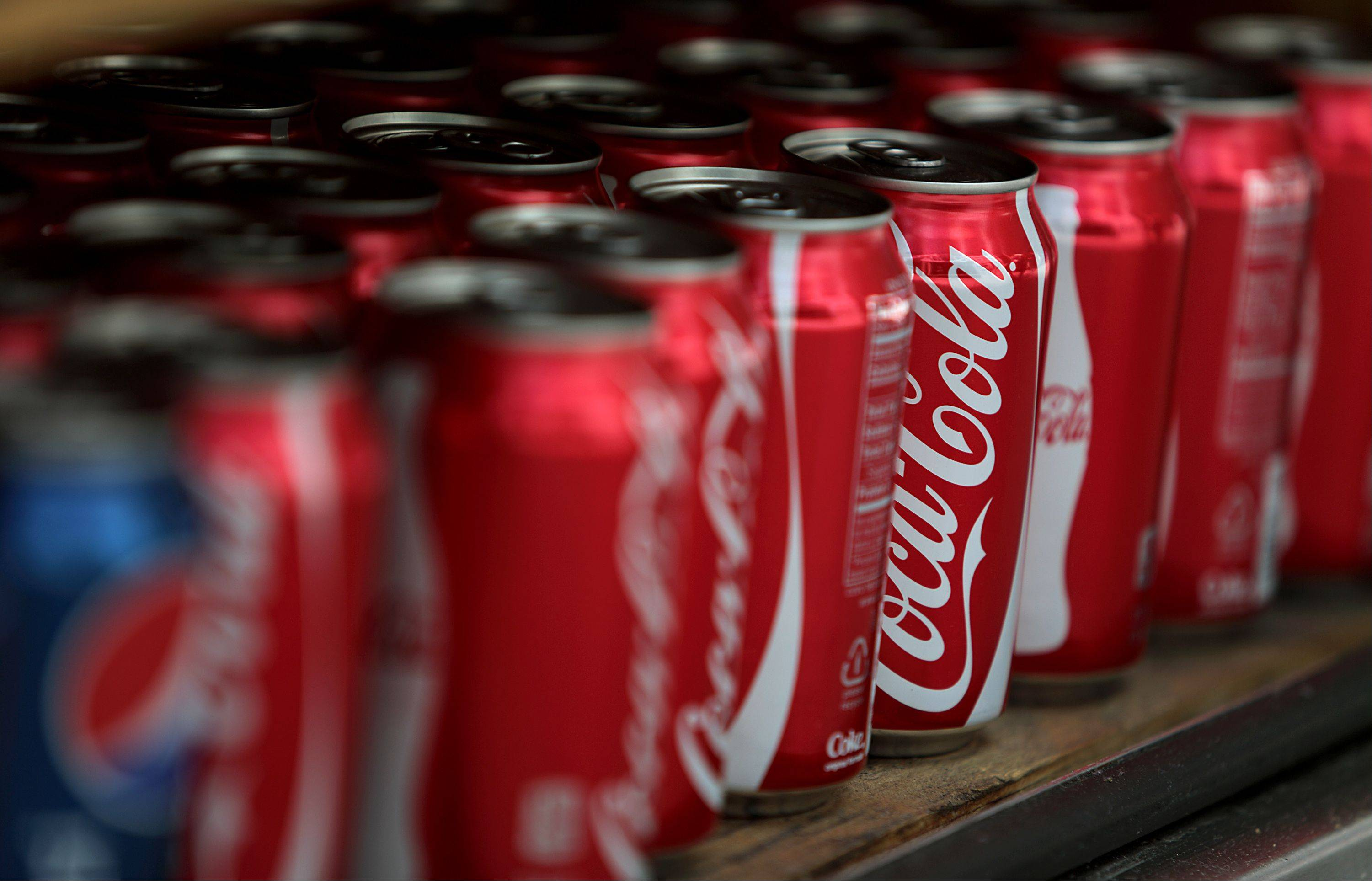 Coca-Cola Co. products are displayed for sale in New York, U.S., on Monday, July 16, 2012. Coca-Cola Co., the world�s largest soft-drink maker, reported second-quarter profit that topped analysts� estimates, helped by pricing increases in North America late last year.