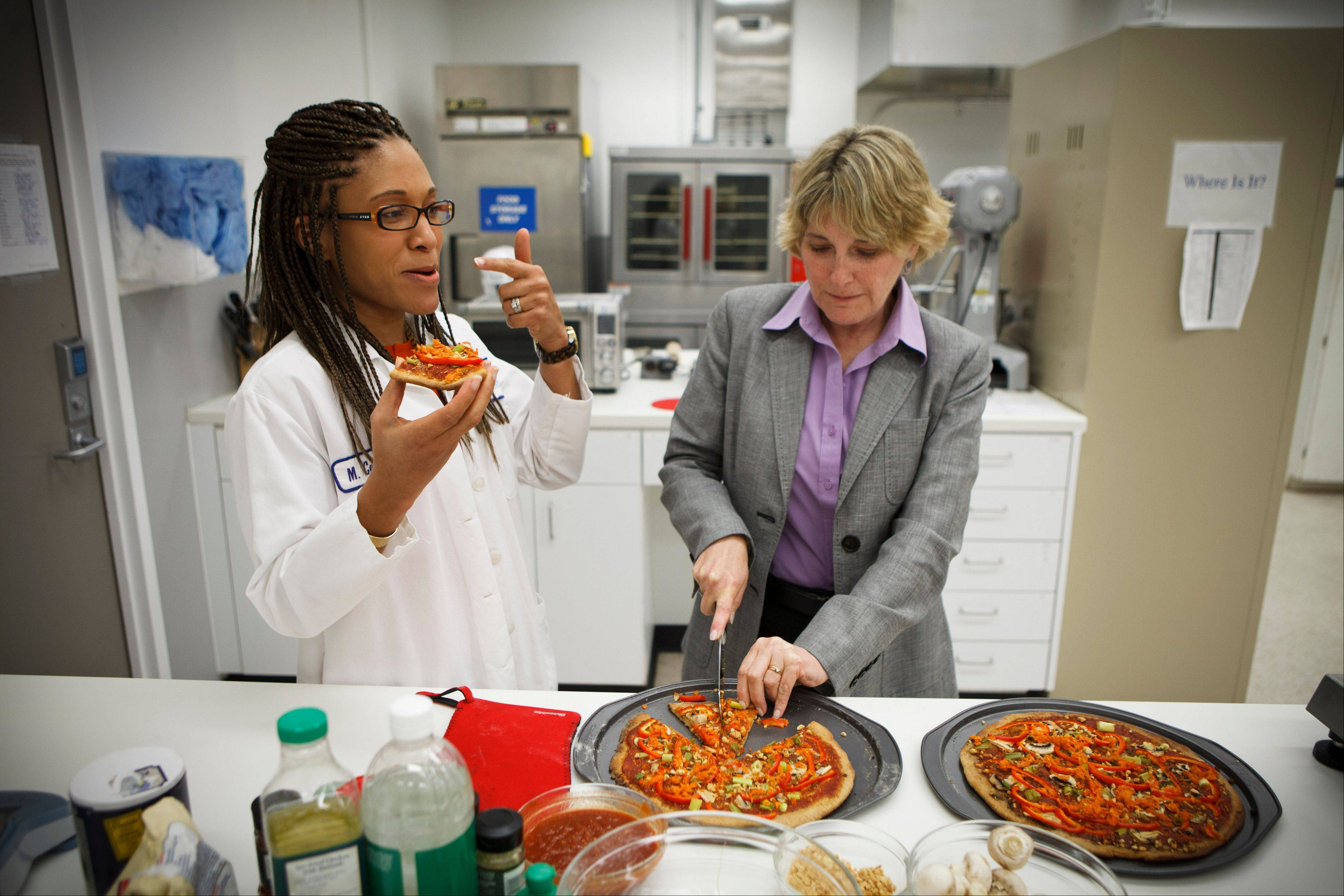 Associated Press NASA�s Advanced Food Technology Project manager Michele Perchonok, right, and Lockeed Martin Sr. Research Scientist Maya Cooper, try a pizza recipe being tested in a kitchen at Johnson Space Center in Houston.