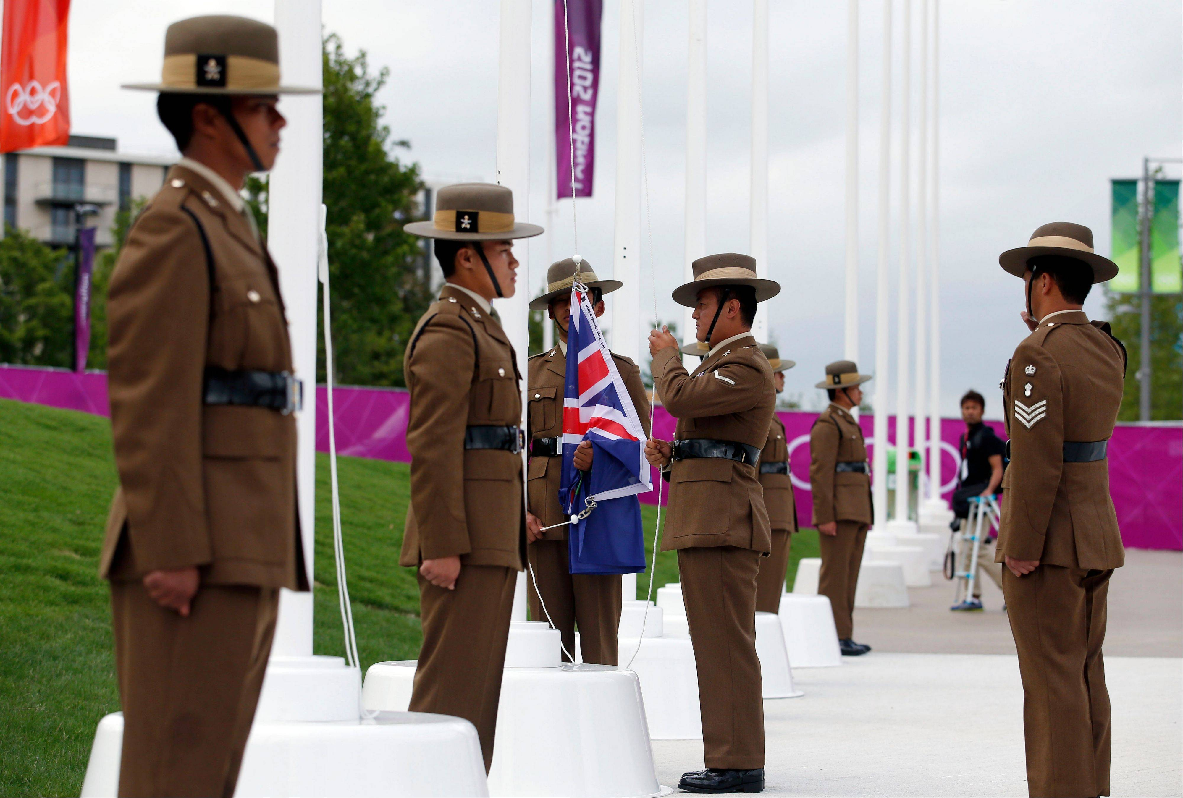 Flag raisers from the British Army raise a British Virgin Islands flag during the Olympic Team Welcome Ceremony at the Olympic Village for the 2012 Summer Olympics, Tuesday, July 17, 2012, in London. Opening Ceremonies for the London Olympics will be held Friday July 27, 2012.