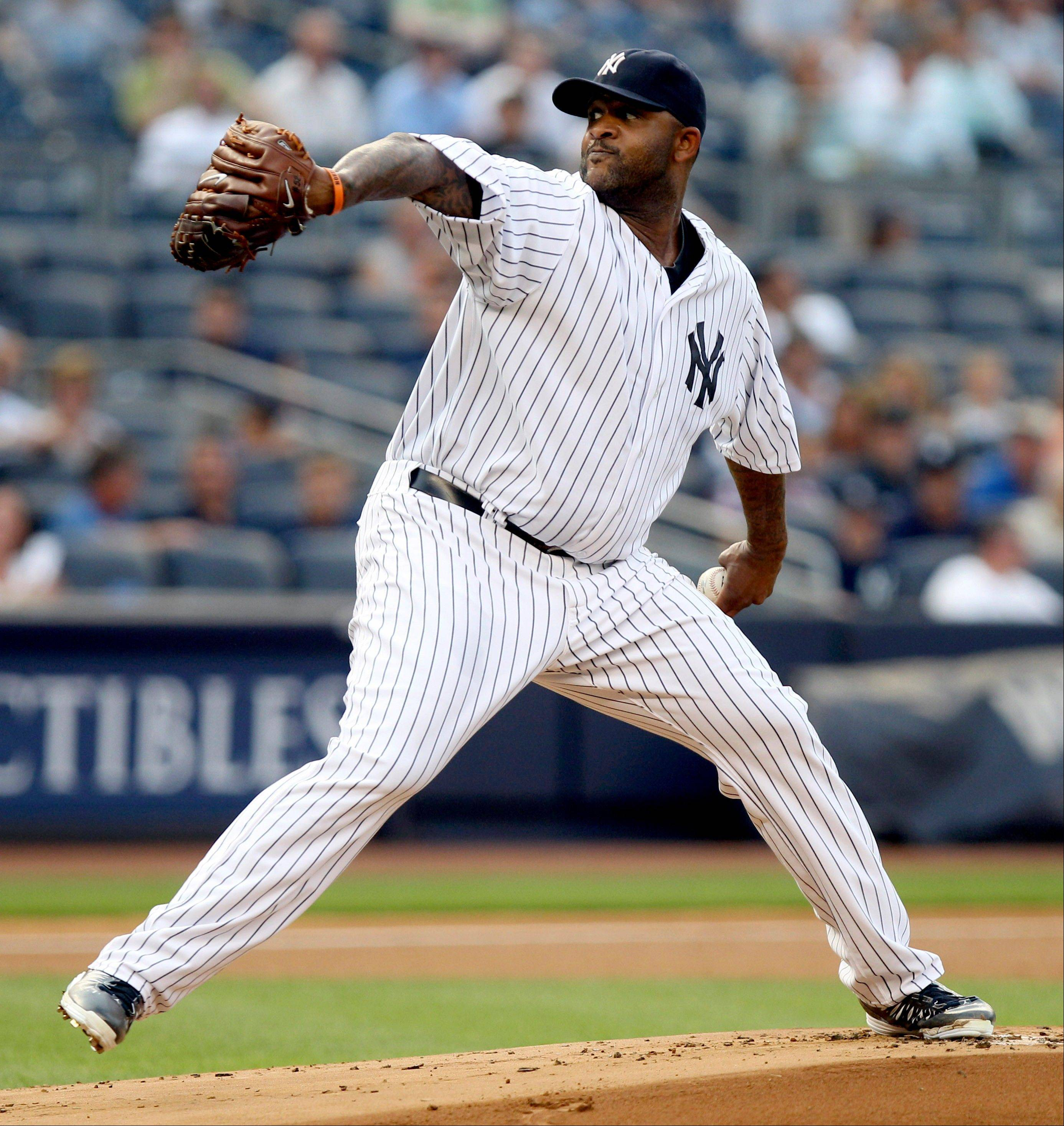 New York Yankees starting pitcher CC Sabathia delivers Tuesday during the first inning against the Toronto Blue Jays, at Yankee Stadium in New York.
