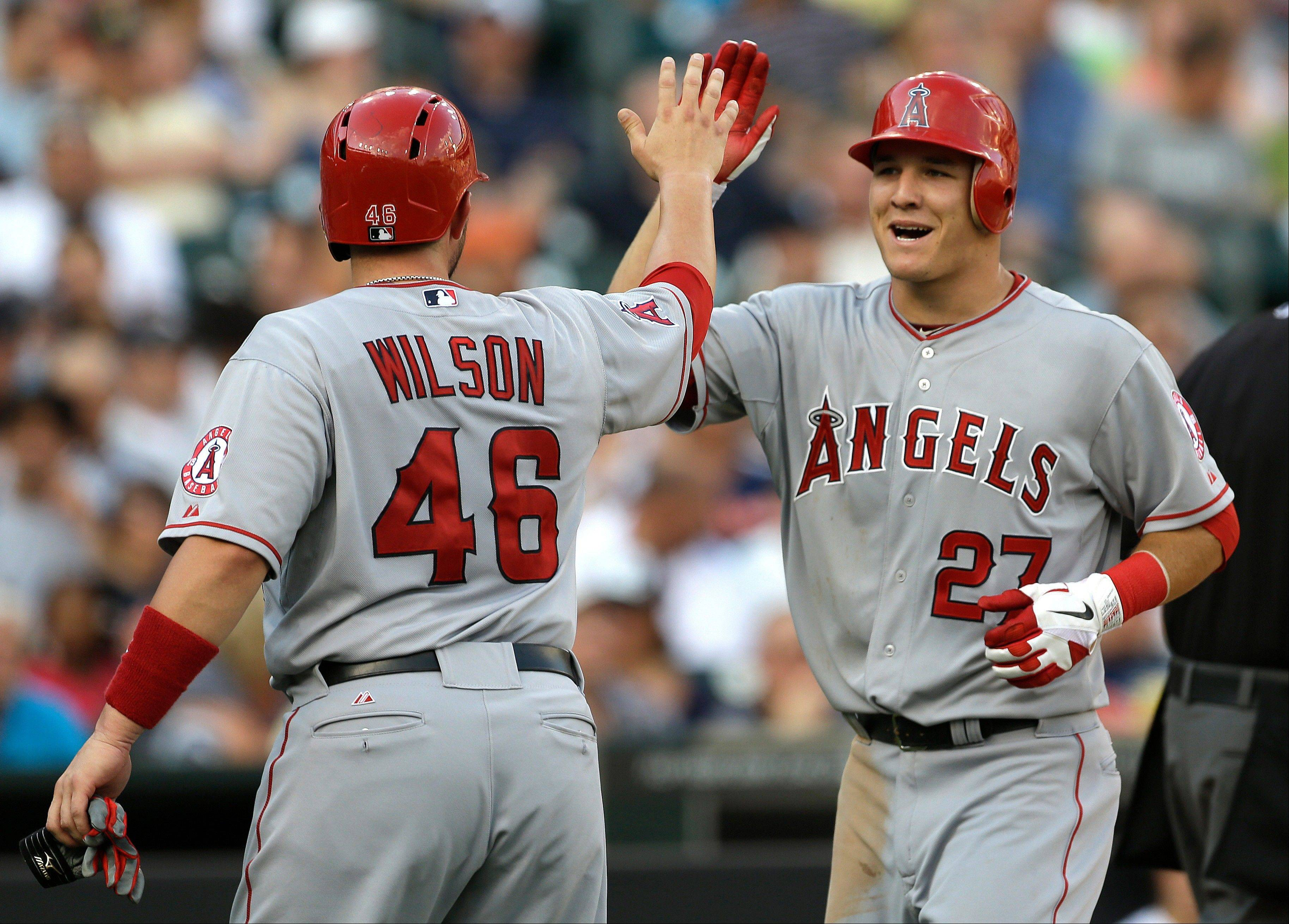 The Los Angeles Angels� Mike Trout (27) is congratulated by Bobby Wilson (46) Tuesday after hitting a 2-run home run against the Detroit Tigers in the second inning oin Detroit.