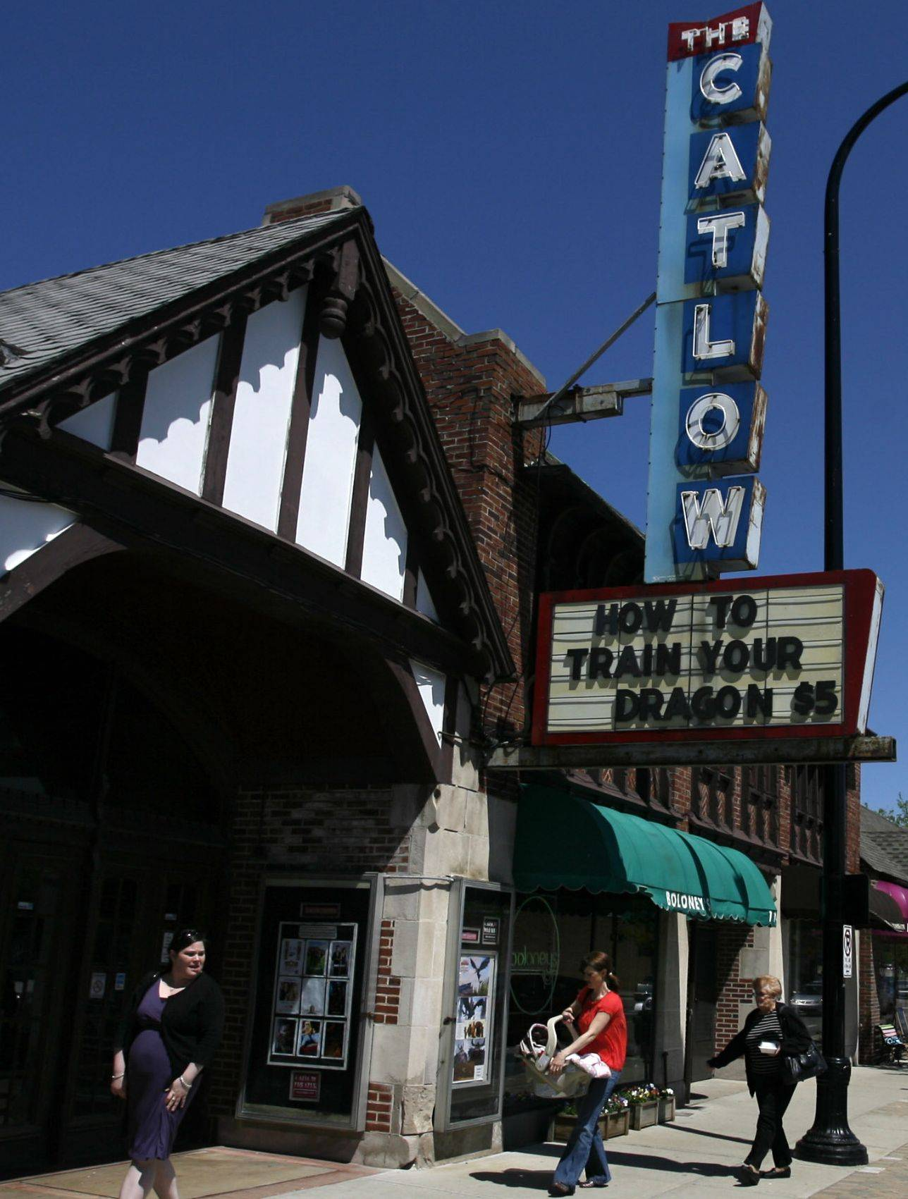 The Catlow Theater in Barrington is debating how to react to distributors' switch to all-digital formats.