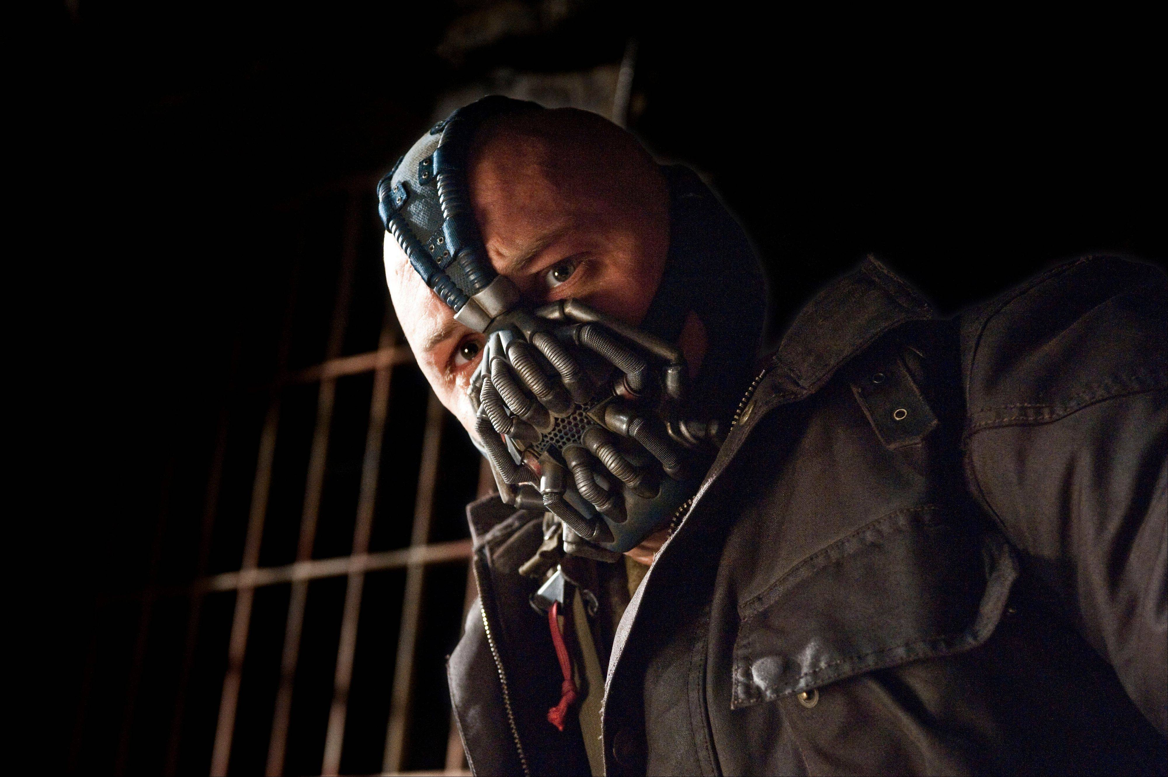 "The villainous Bane (Tom Hardy) plots against Gotham City in ""The Dark Knight Rises."""