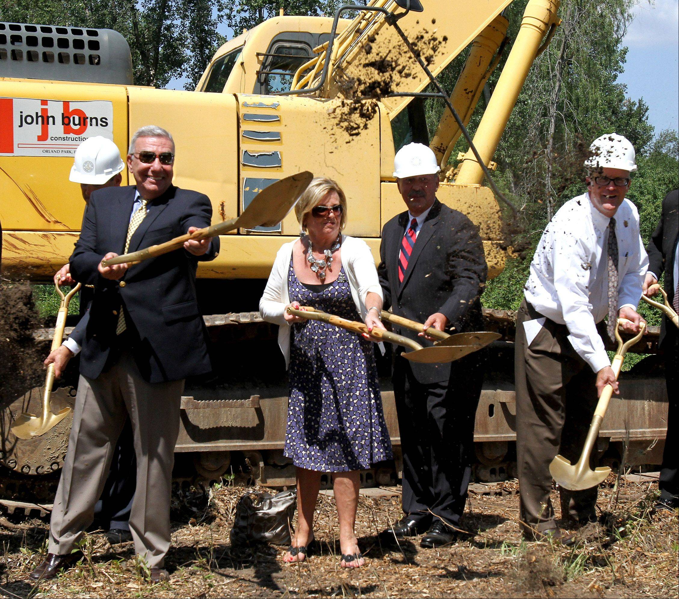 Tom and Pat Nicarico, left, take part in the groundbreaking ceremony for the new Jeanine Nicarico Children's Advocacy Center in Wheaton on Tuesday. On the right is DuPage County Board Chairman Dan Cronin.