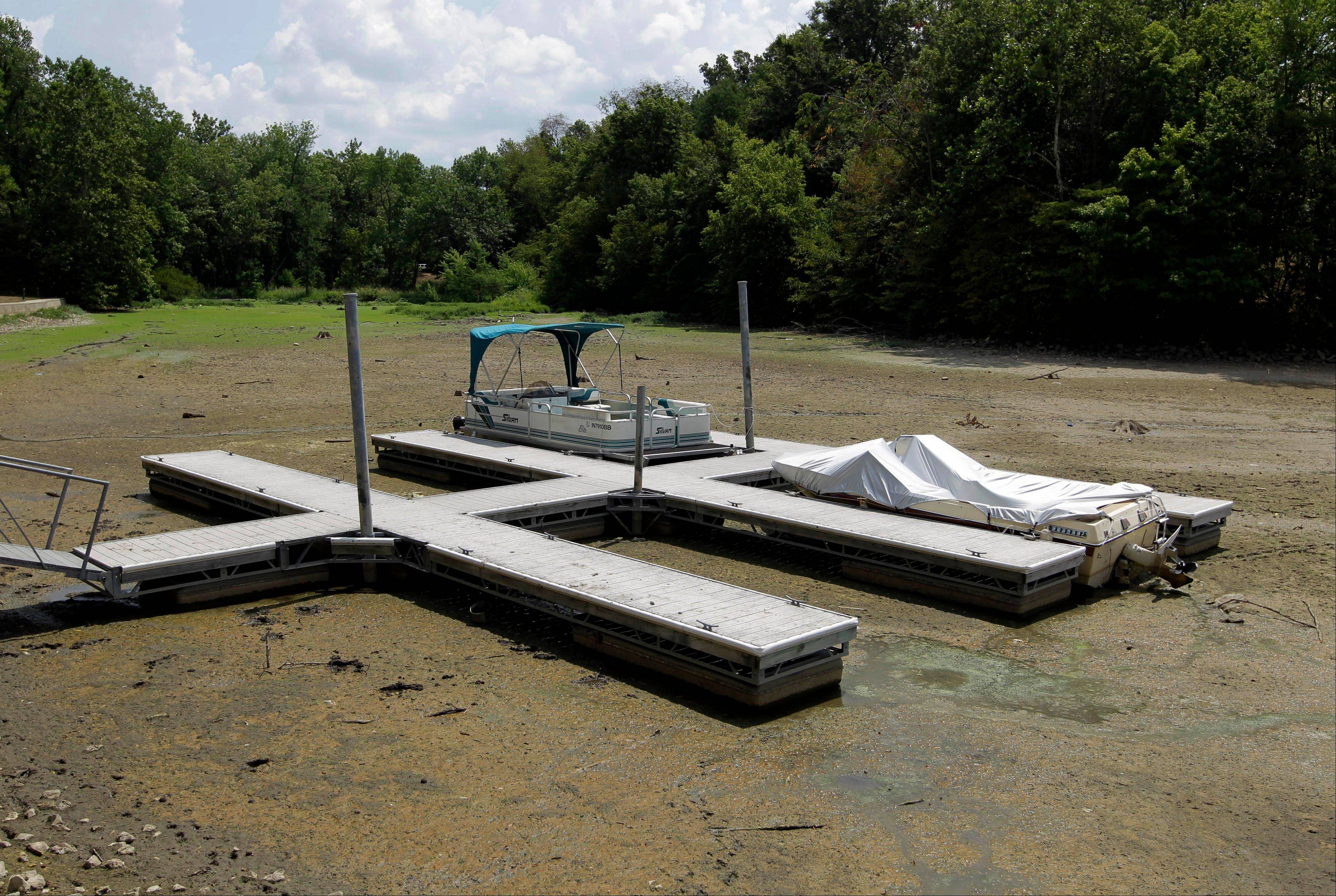 Boats sit on the bottom in a dry cove at Morse Reservoir in Noblesville, Ind., Monday, July 16, 2012. The reservoir is down nearly 6 feet from normal levels and being lowered 1 foot every five days to provide water for Indianapolis.