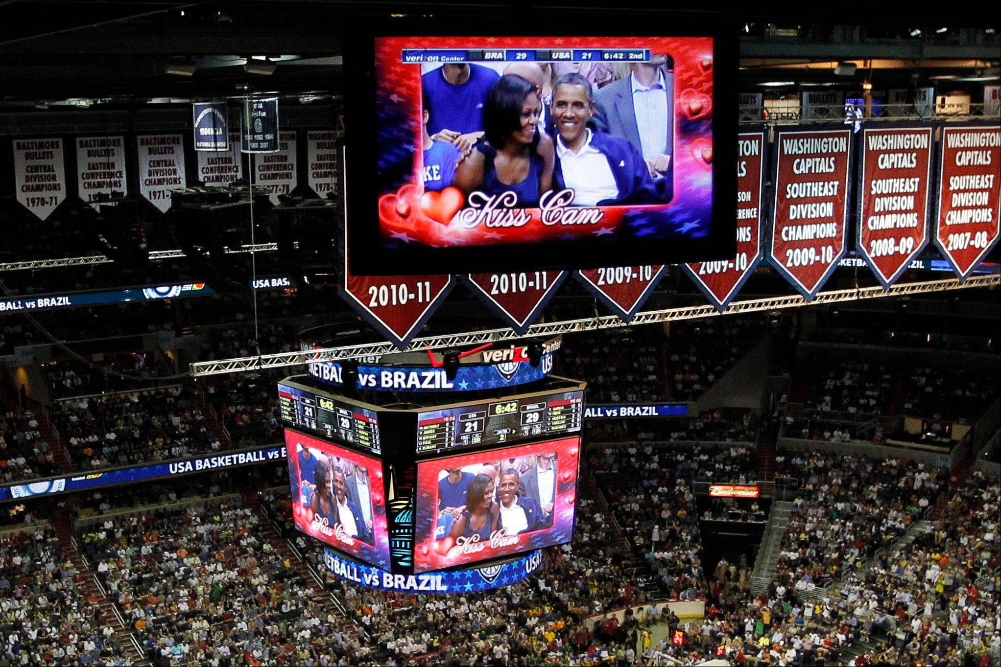 "President Barack Obama and first lady Michelle Obama are seen on the in-house television monitors during the ''Kiss Cam"" segment as they attend the U.S. men's Olympic basketball exhibition game between Team USA and Brazil in Washington, Monday, July 16, 2012."
