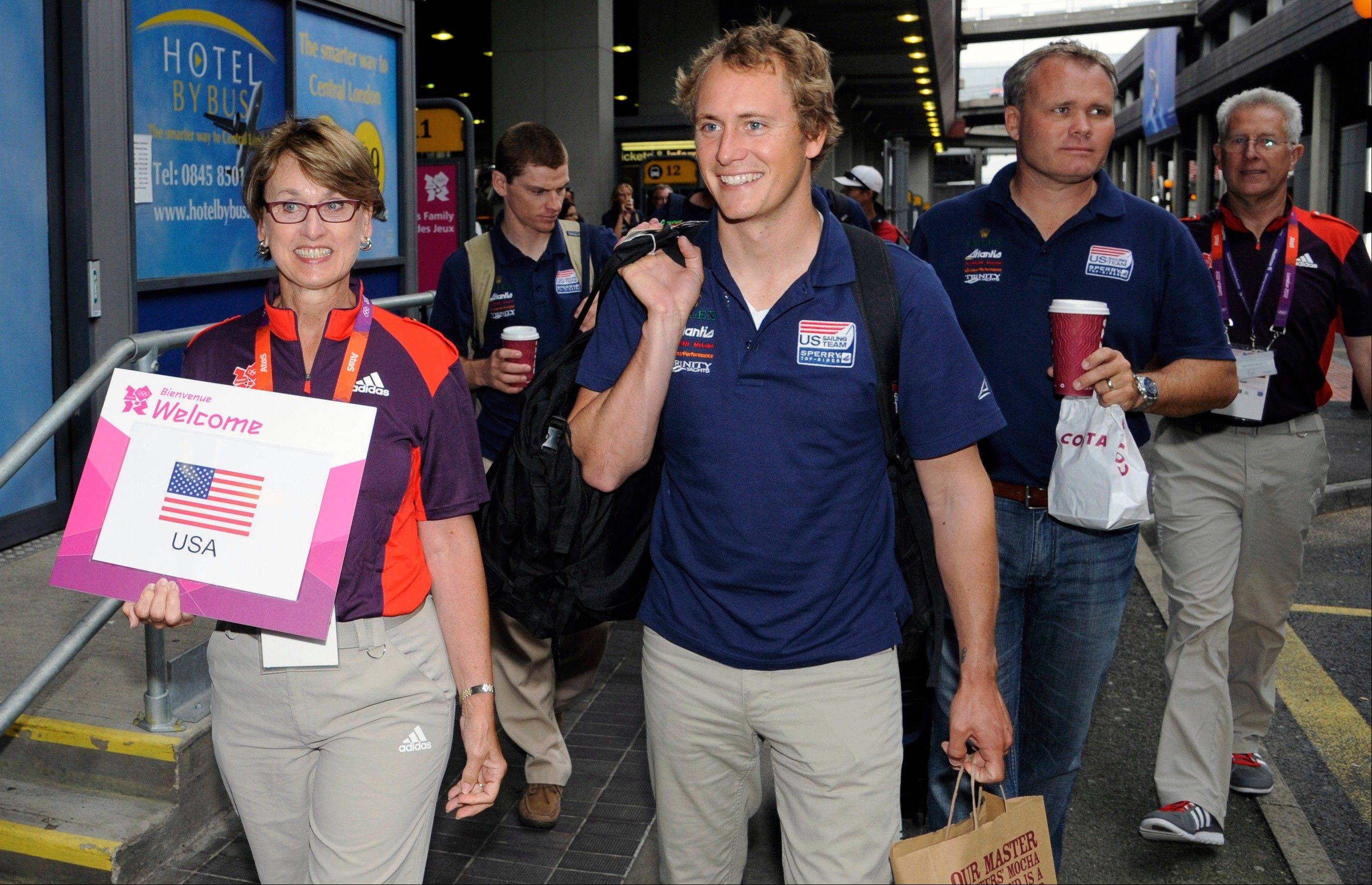 Members of the U.S. Olympic sailing team are escorted following their arrival Monday at Heathrow Airport in London, where arriving athletes added to a record number of passengers. The Games begin July 27 and run through Aug. 12.