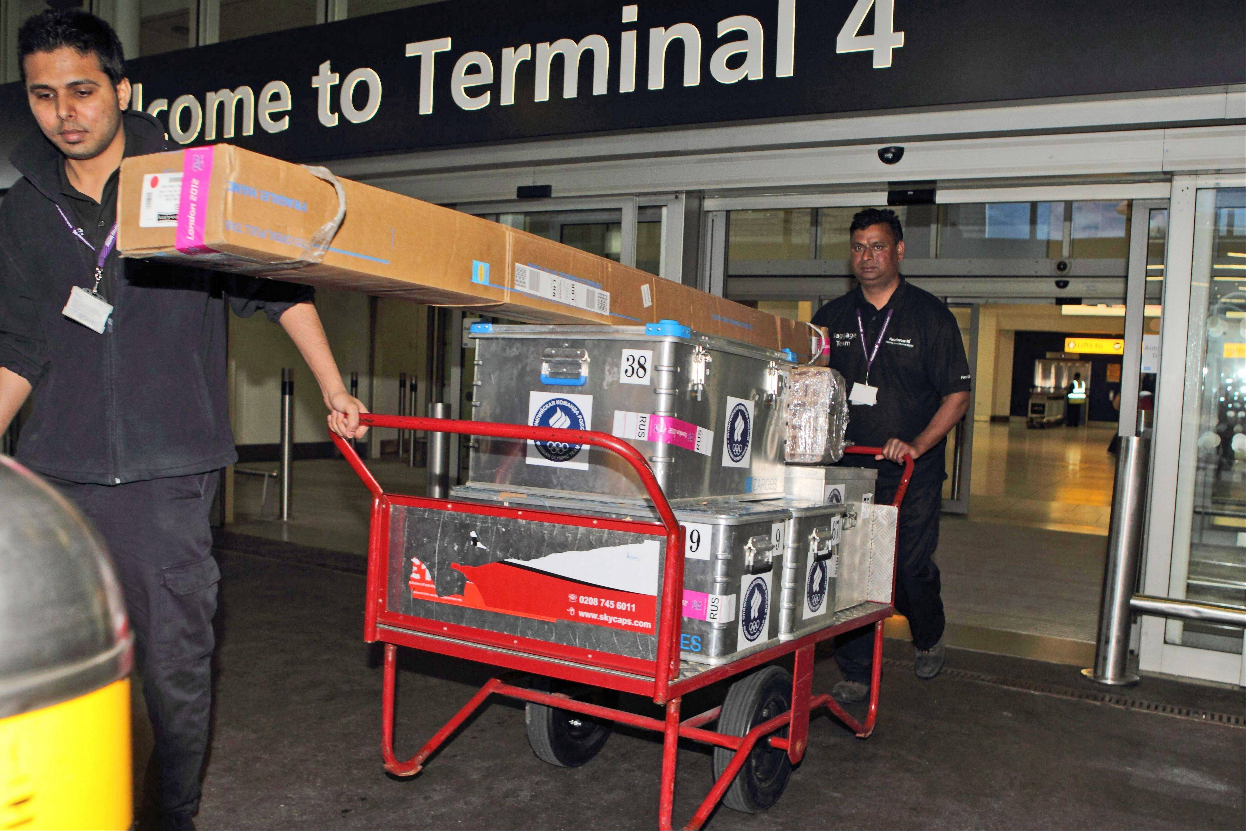 Traveling with bulky, odd-shaped athletic equipment is just part of the Olympic challenge for athletes. This cart belongs to members of the Russian Olympic team arriving Monday at Heathrow Airport in London.