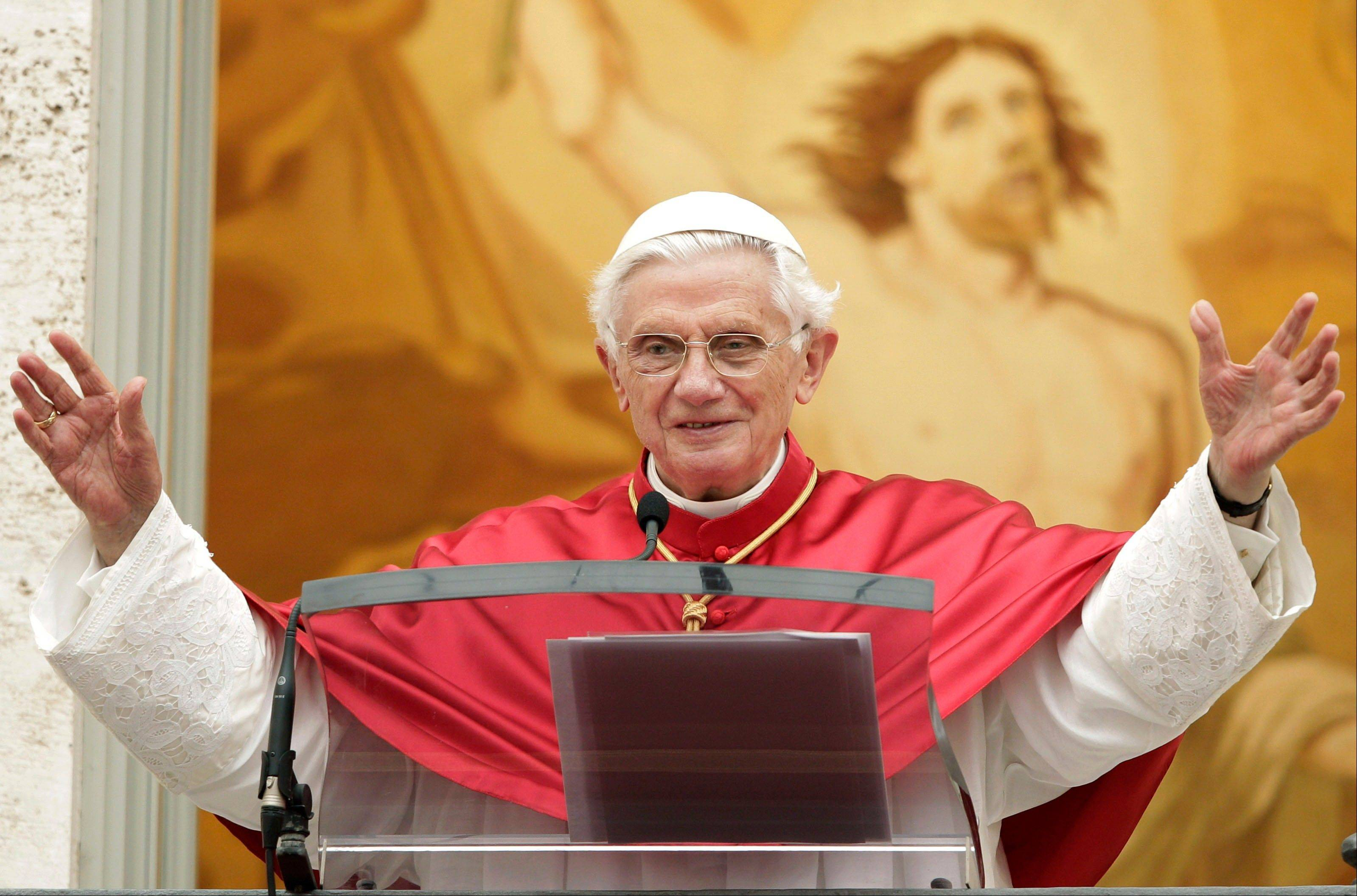 Pope Benedict XVI waves to faithful during the Angelus prayer at his summer residence of Castel Gandolfo, in the outskirts of Rome, Sunday, July 15, 2012.