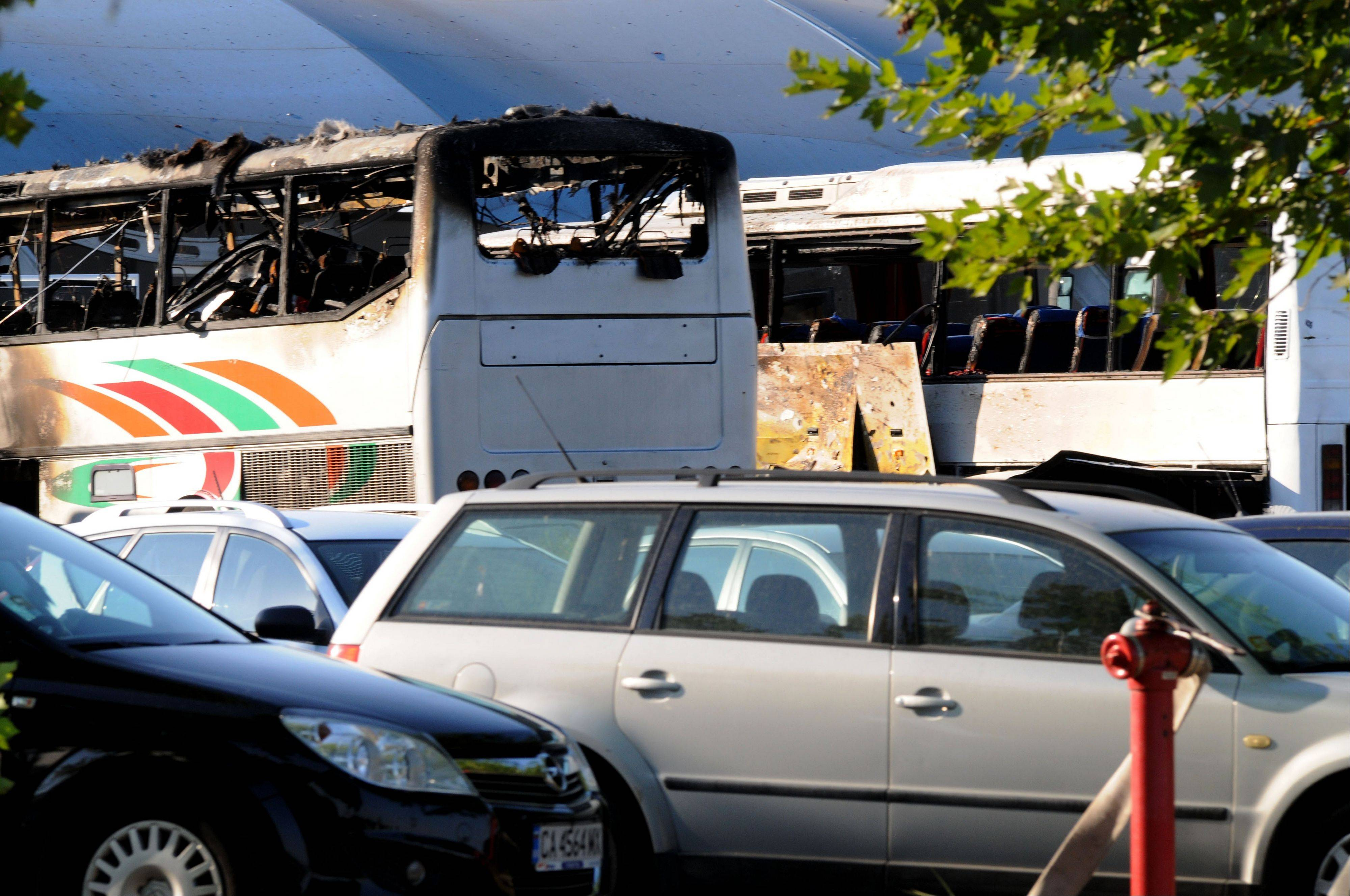 Destroyed buses are seen at Burgas airport, outside the Black Sea city of Burgas, Bulgaria, some 250 miles east of the capital, Sofia, Wednesday. A bus carrying young Israeli tourists in a Bulgarian resort exploded Wednesday, killing seven people.