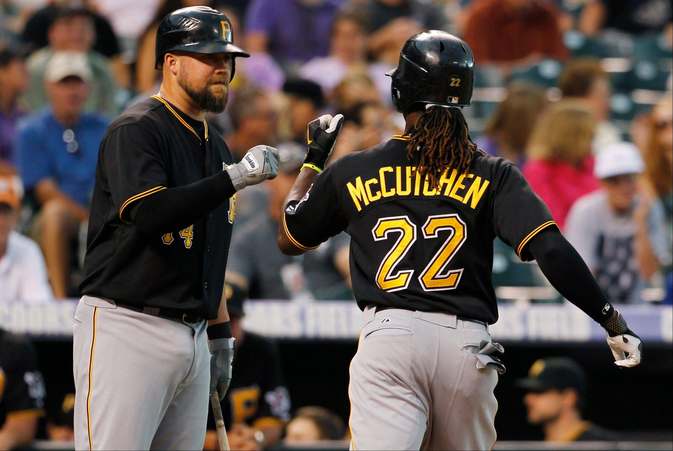 The Pittsburgh Pirates' Casey McGehee, left, congratulates Andrew McCutchen as he returns to the dugout Tuesday after hitting a solo home run against the Colorado Rockies during the fourth inning of the Pirates' 6-2 victory in Denver.