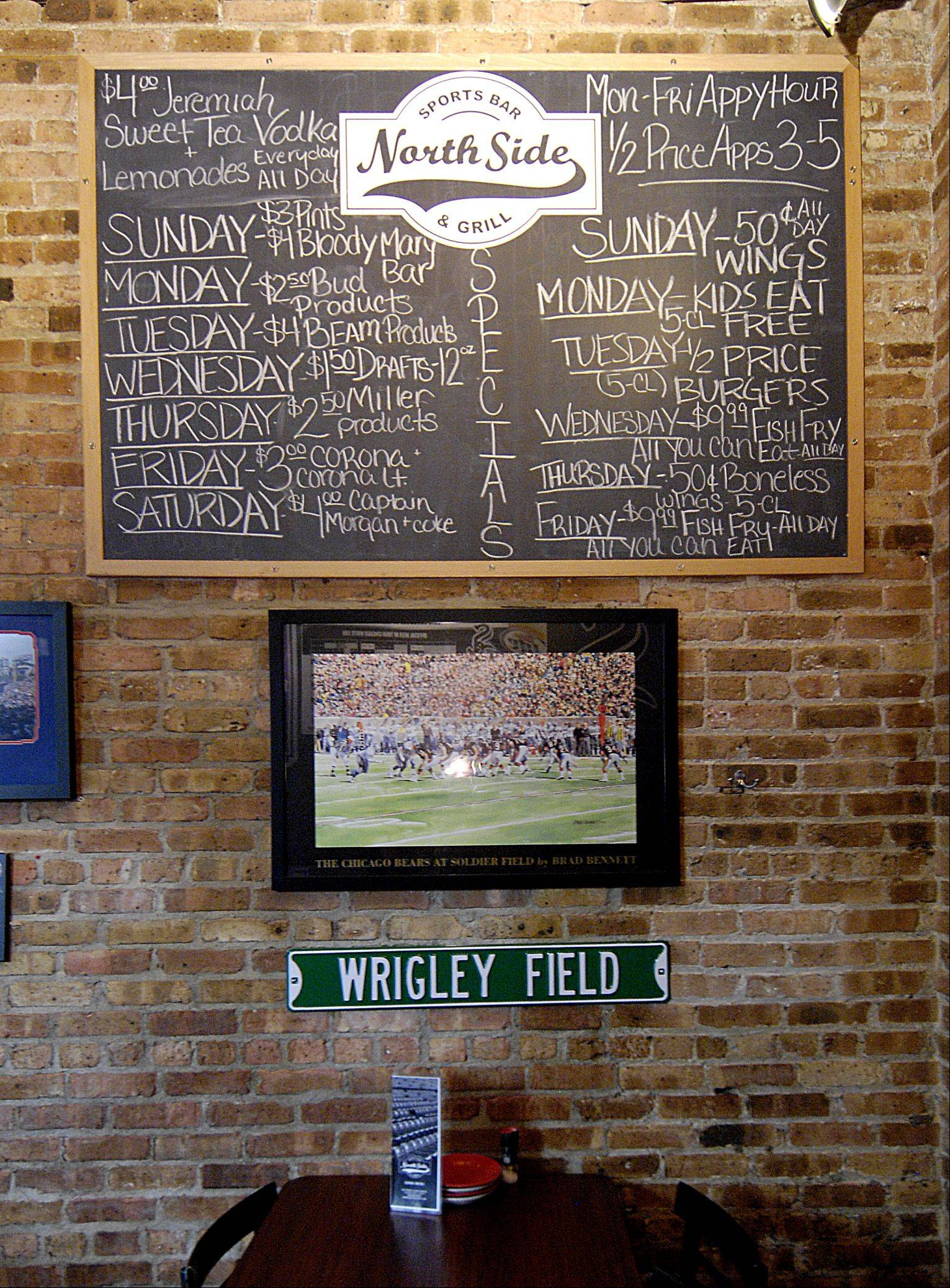 A chalkboard showcases the specials at the North Side Sports Bar & Grill in Glen Ellyn.