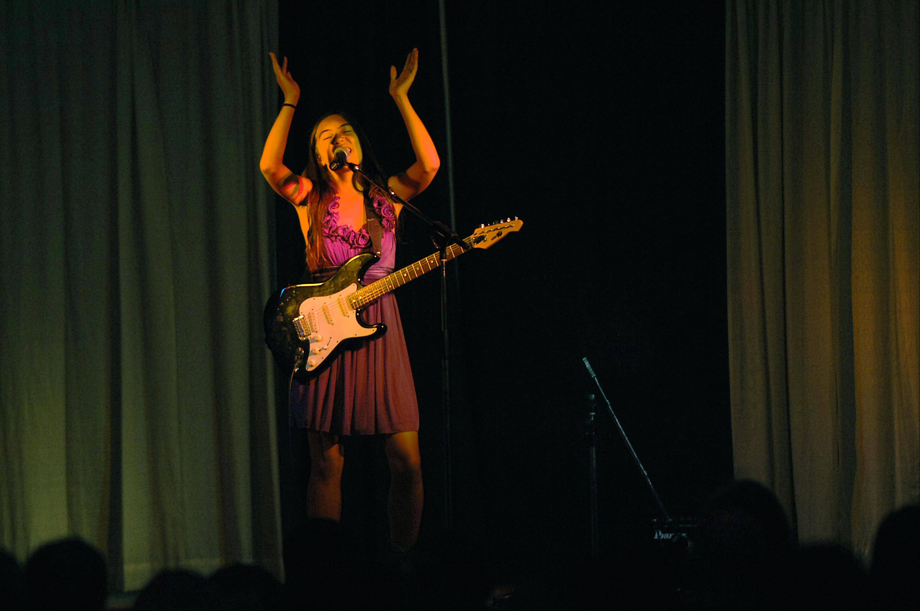 "Alexis Nguyen, 13, of Pingree Grove, performs ""Good Girl"" Monday night at the 29th Annual Kane County Fair Talent Contest in the Prairie Events Center at the fairgrounds in St. Charles."
