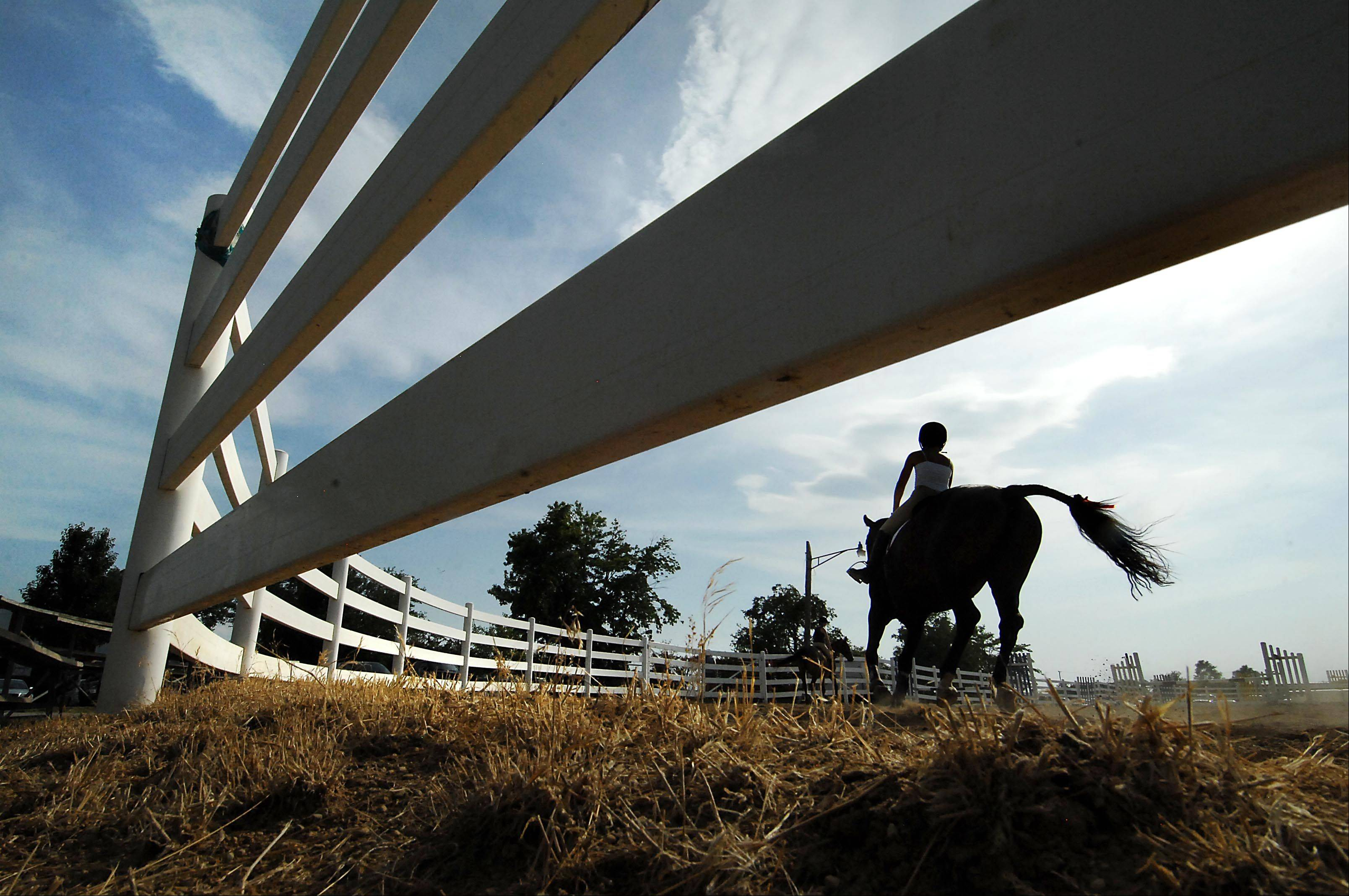 A young rider practices on the first day of the Kane County Fair Wednesday in St. Charles.