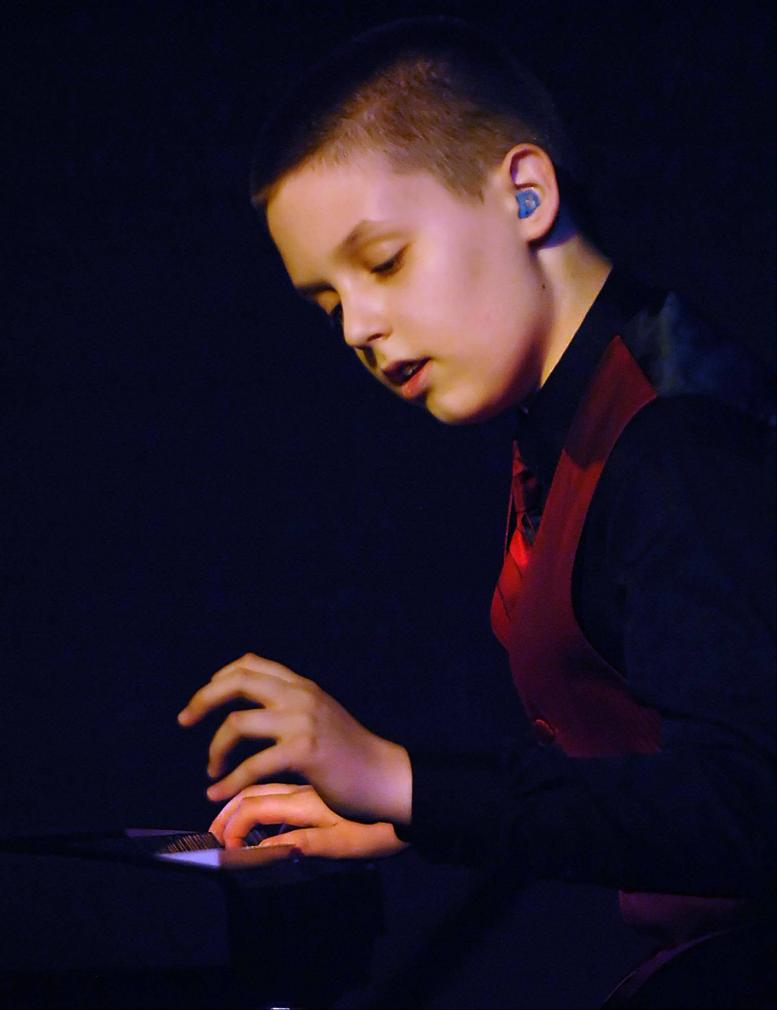 Eleven-year-old Daniel Souvigny of Hampshire performs a piano solo Monday night at the 29th Annual Kane County Fair Talent Contest in the Prairie Events Center at the fairgrounds in St. Charles. He competed in the junior division.