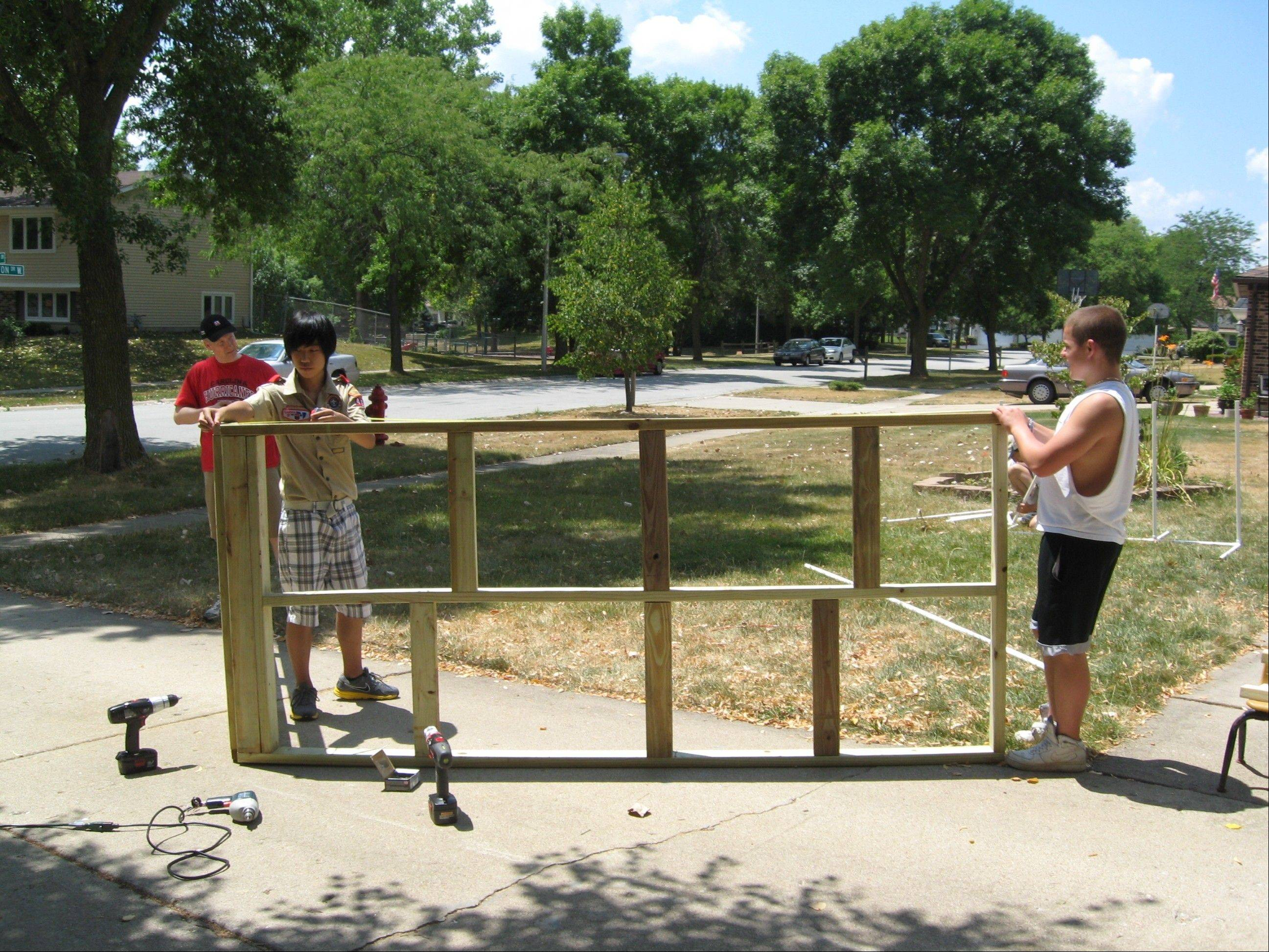 "Christopher Umeki, 15, of Hoffman Estates builds a piece of agility equipment that will be installed in a new dog park in the village next month as part of his Eagle Scout project. The Hoffman Estates Park District, in cooperation with the city of Elgin and Streamwood Park District, is opening ""Freedom Run"" at 6150 Russell Road."