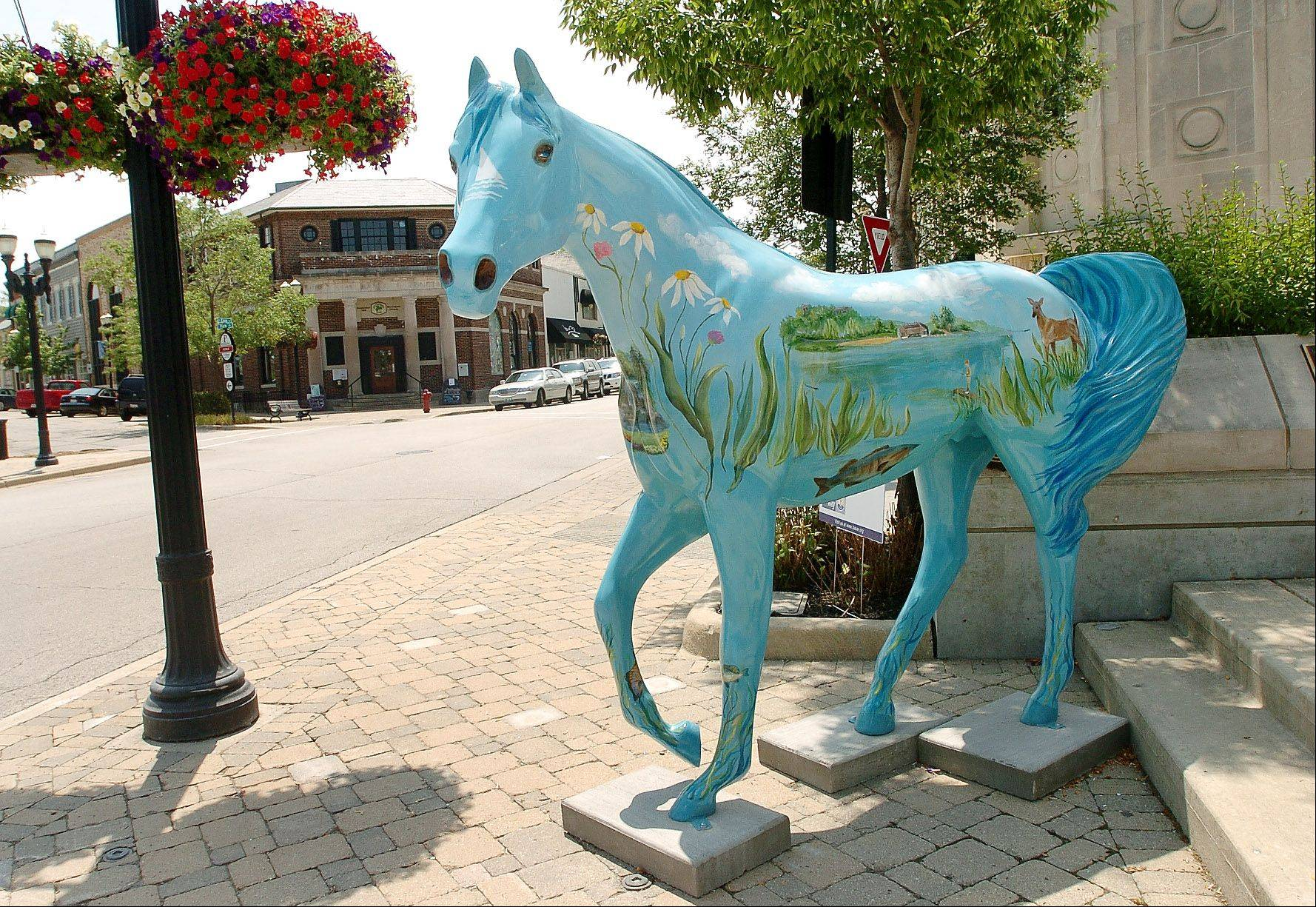 "Decorated ceramic horses are on display throughout Barrington as part of a fundraiser for the Barrington Area United Way. This one called ""Natural Scapes"" by artist Kathy Losch is sponsored by the Lake Barrington Shores HOA."