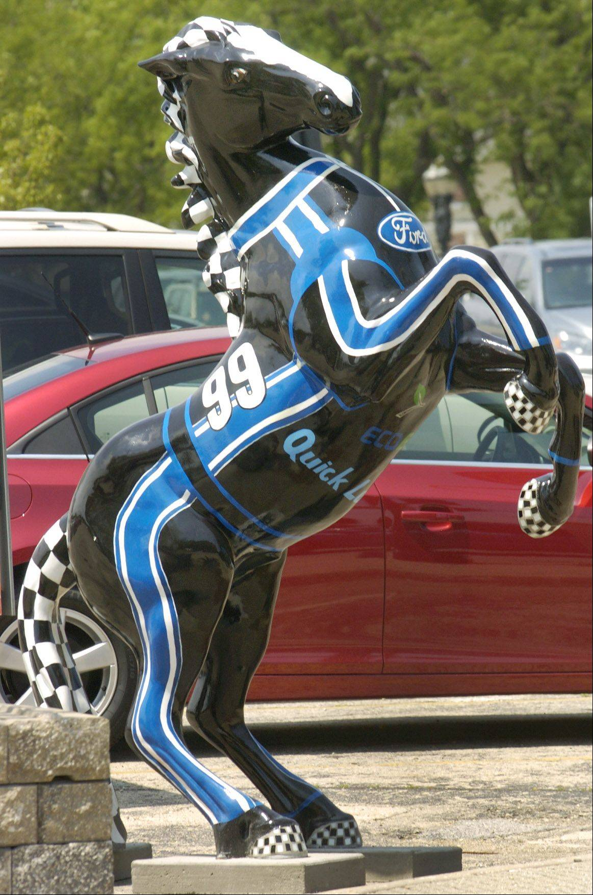"Decorated ceramic horses are on display throughout Barrington for a Barrington Area United Way fundraiser. This one called ""Mustang"", on the corner of Hough and Main streets, is by artist Merike Adams and sponsored by Wickstrom Auto Group."