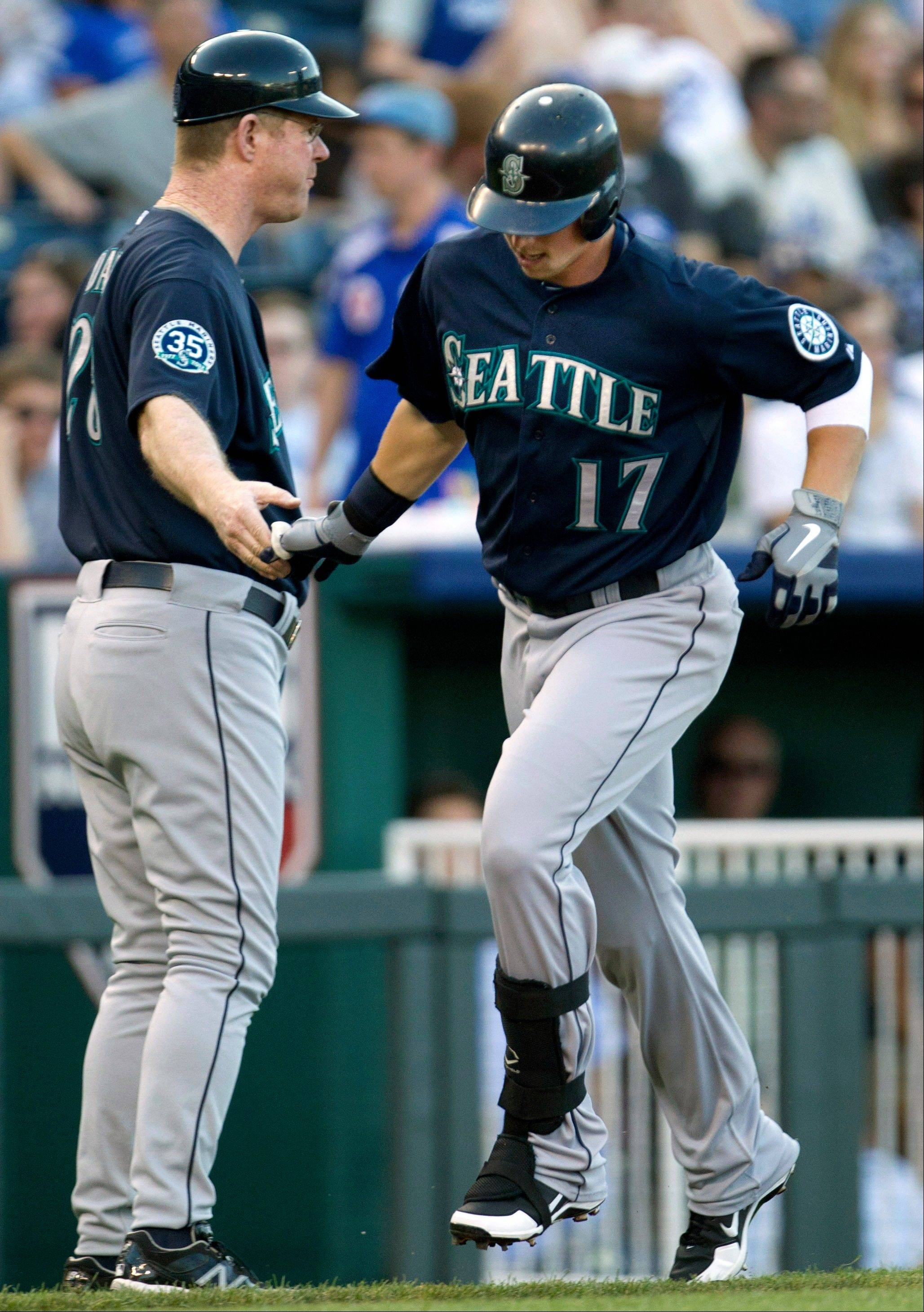 The Seattle Mariners' Justin Smoak (17) is congratulated by third base coach Jeff Datz Tuesday after his two-run home run off Kansas City Royals starting pitcher Ryan Verdugo during the first inning at Kauffman Stadium in Kansas City, Mo.
