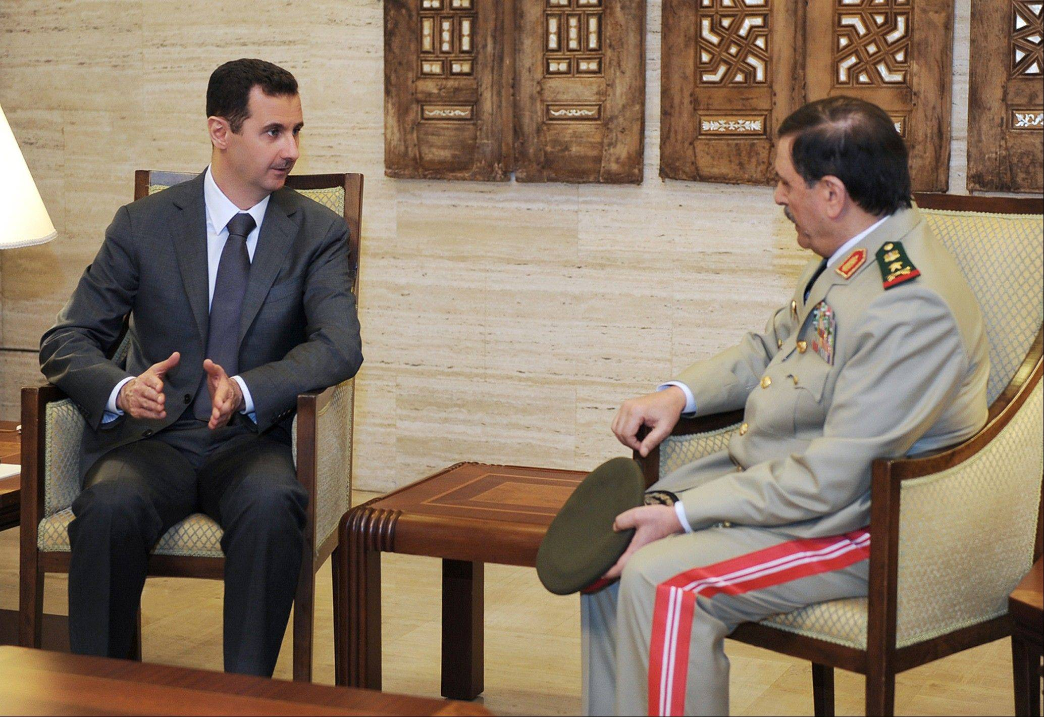 In this photo released by the Syrian official news agency SANA, Syrian President Bashar Assad, left, meets with Fahd Jassem al-Freij, Syria�s new Defense Minister, in Damascus Thursday.