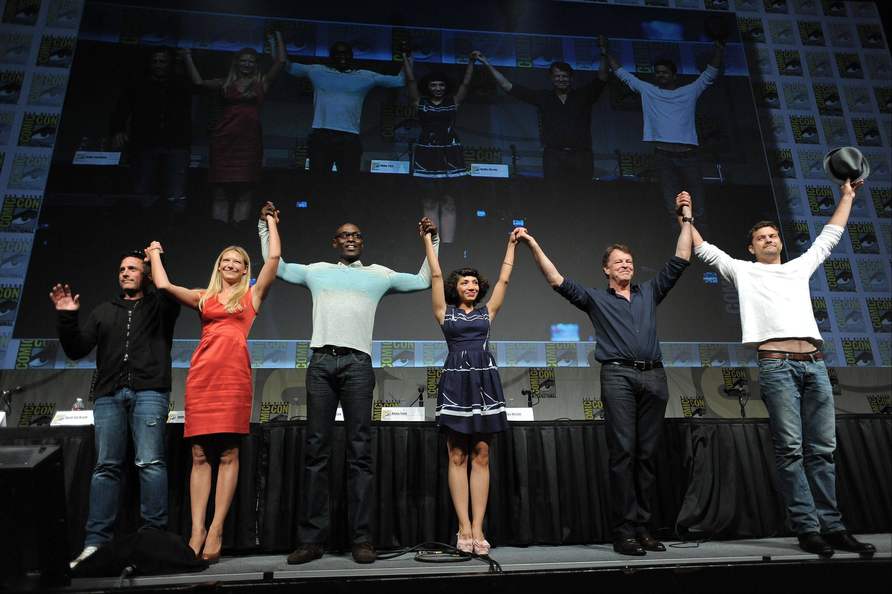 "J.H. Wyman, Anna Torv, Lance Reddick, Jasika Nicole, John Noble and Joshua Jackson take a final bow at the ""Fringe"" screening and panel at Comic-Con earlier this week."